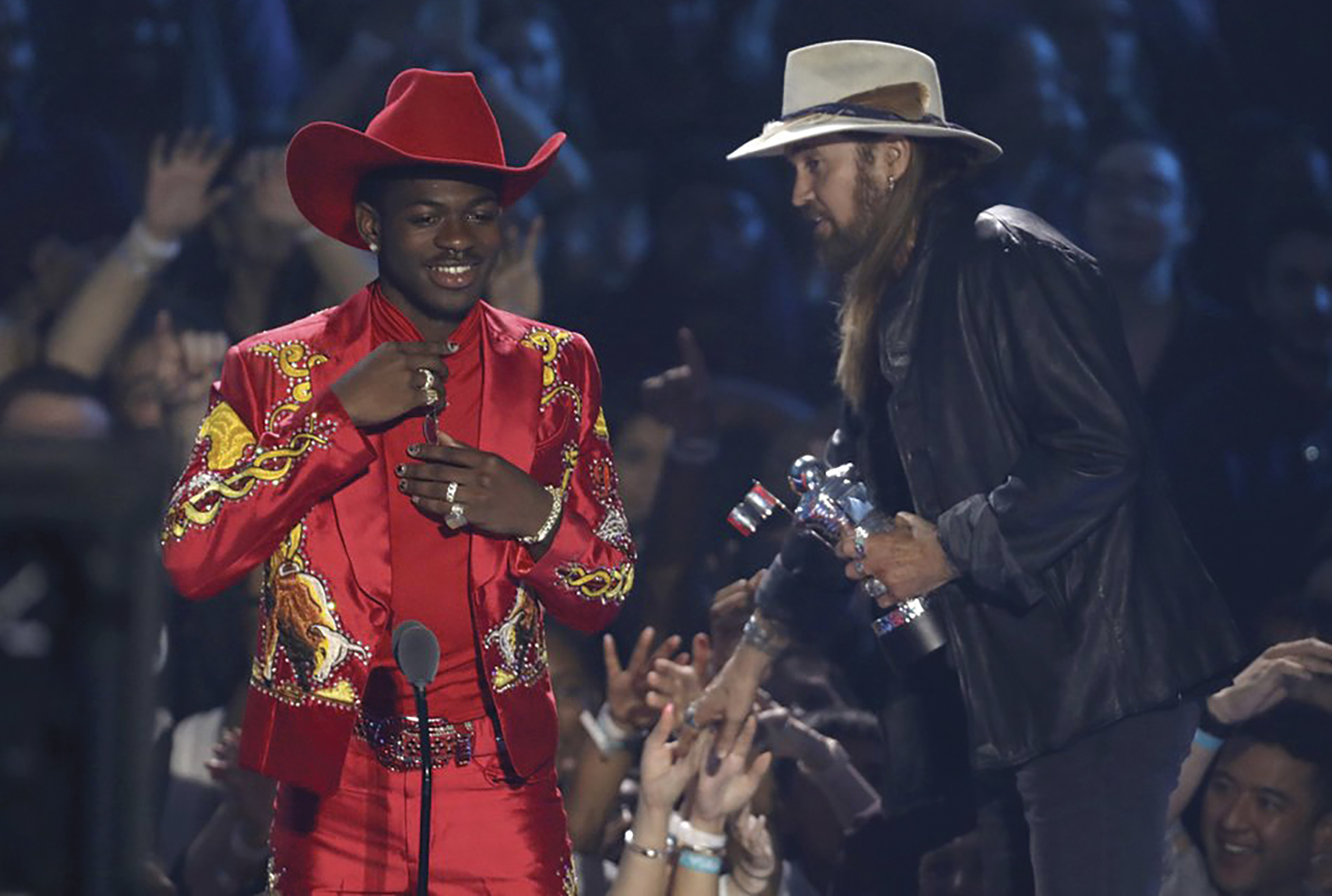 """Lil Nas X, left, and Billy Ray Cyrus accept the song of the year award for """"Old Town Road"""" at the MTV Video Music Awards at the Prudential Center on Monday, Aug. 26, 2019, in Newark, N.J. (Photo by Matt Sayles/Invision/AP)"""