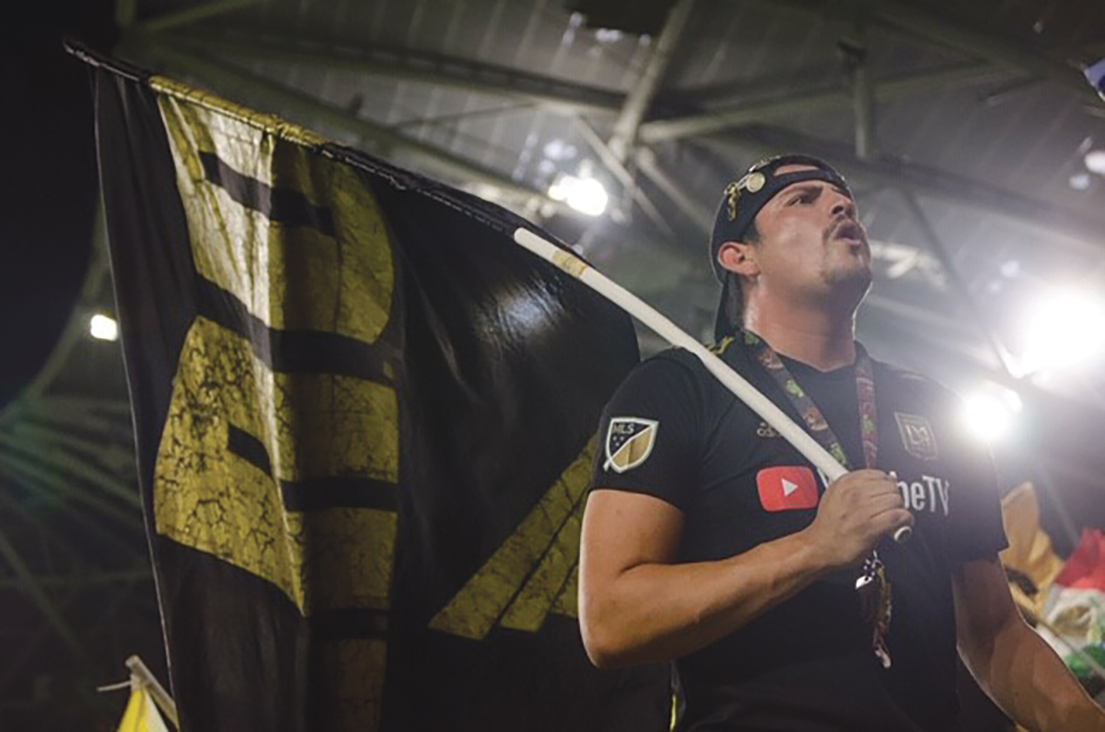 LAFC Supporter with Flag. (K Preston Photography)