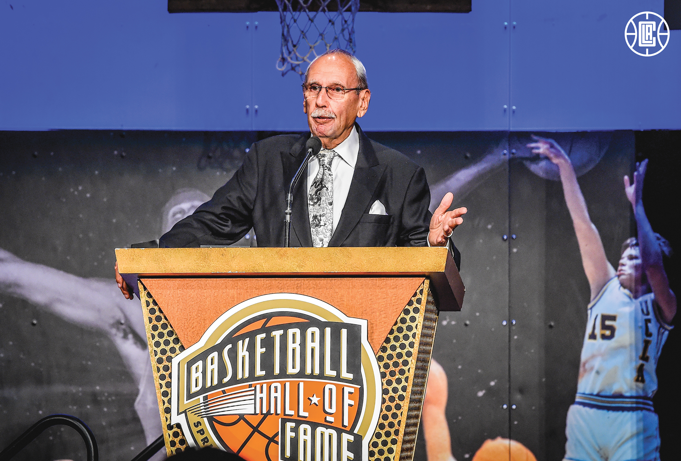 """Ralph Lawler, """"The Voice of The Clippers,"""" speaks after being inducted into the Naismith Hall of Fame. (L.A. Clippers Courtesy Photo)"""