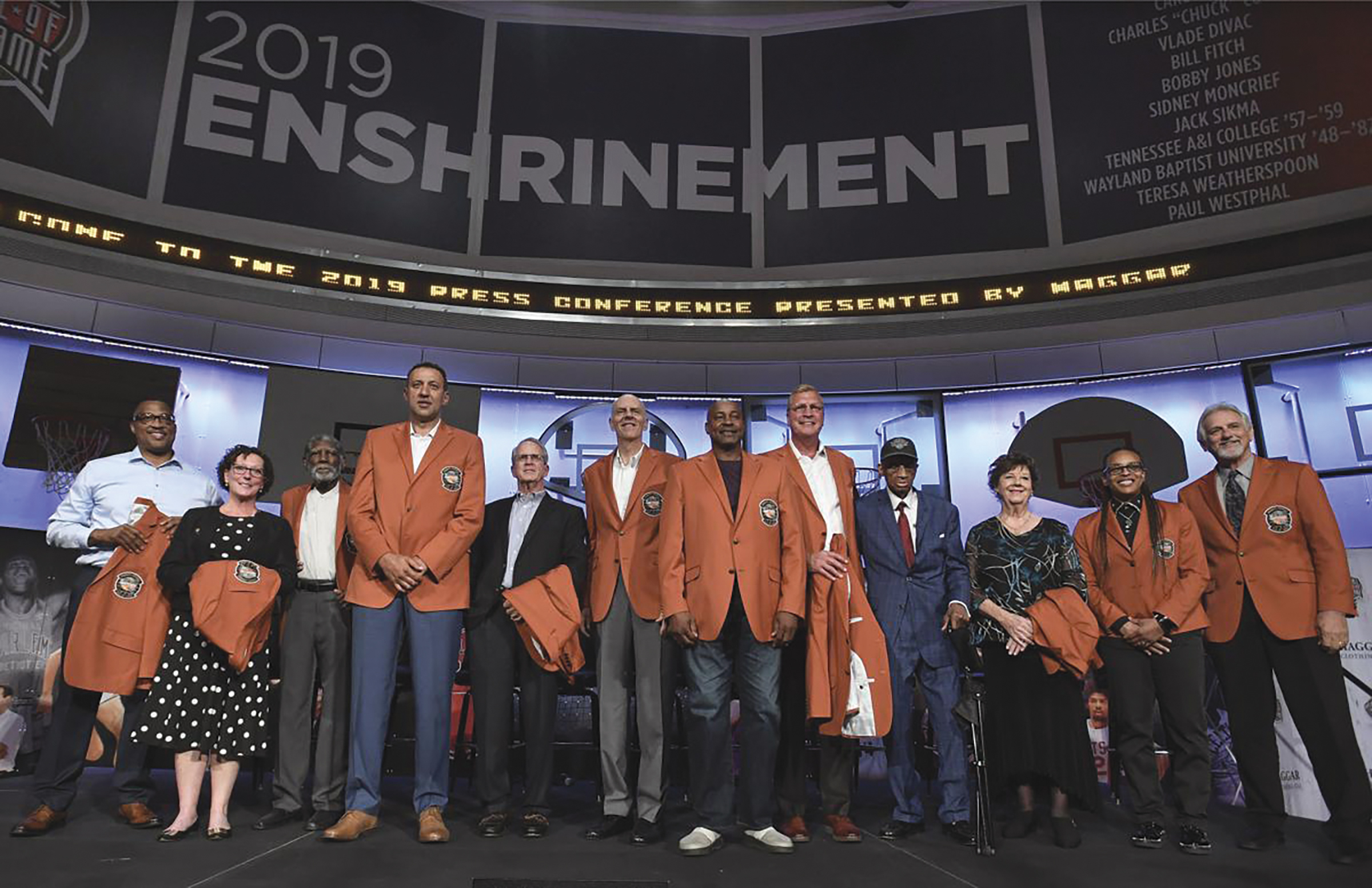 Class of 2019 inductees into the Basketball Hall of Fame, from left to right, Chuck Cooper III, accepting on behalf of his late father Chuck Cooper, Susan Braun, accepting on behalf of her later father Carl Braun, Al Attles,Vlade Divac, Ron Coville accepting on behalf of his father-in-law, Bill Fitch, Bobby Jones, Sidney Moncrief, Jack Sikma, Dick Barnett for Tennessee A&I, Linda Price for Wayland Baptist, Teresa Weatherspoon, and Paul Westphal, pose for a photo during a news conference at the Naismith Memorial Basketball Hall of Fame, Thursday, Sept. 5, 2019, in Springfield, Mass. (AP Photo/Jessica Hill)