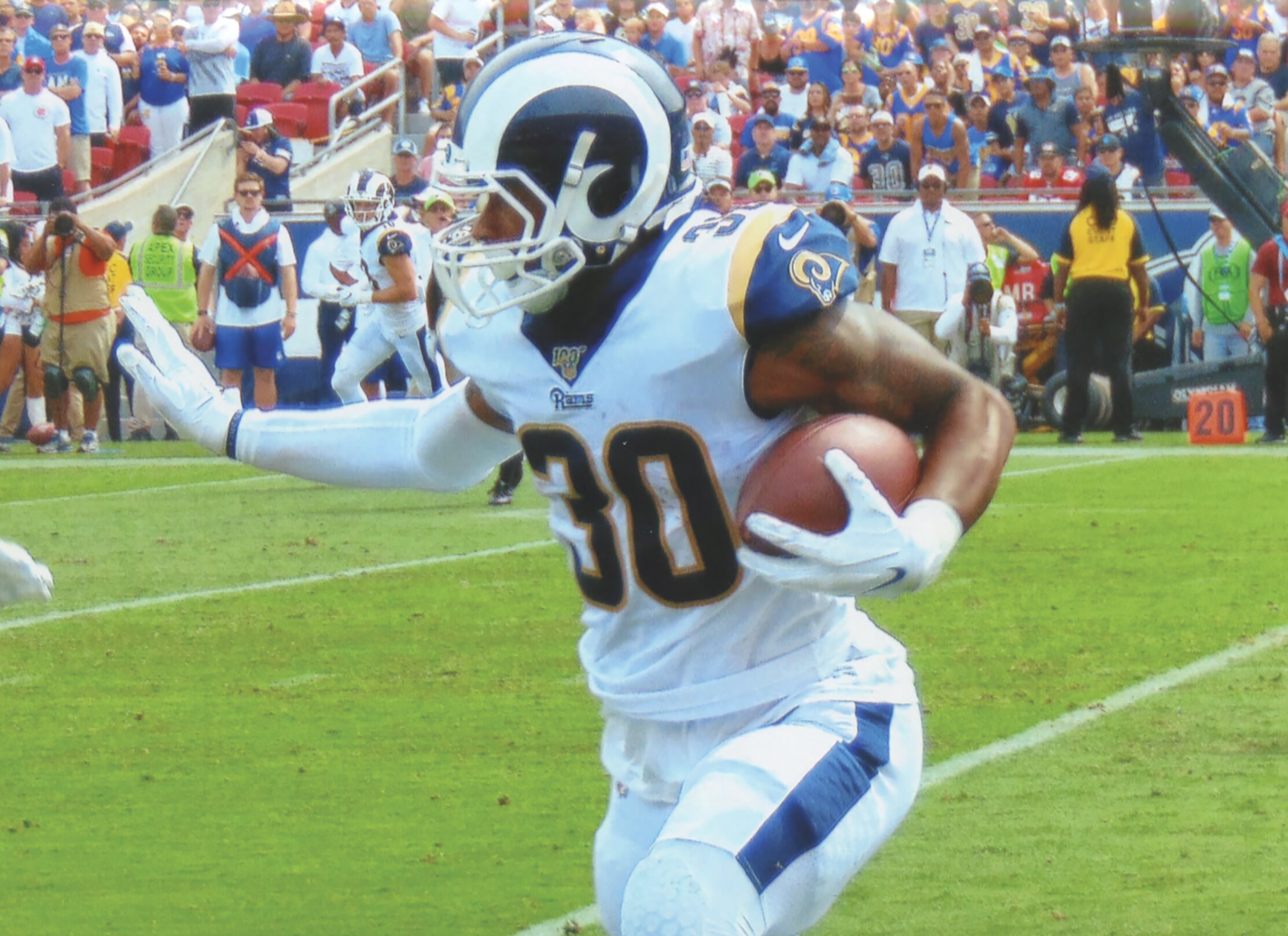 Todd Gurley (30) helps the Rams produce nearly 400 yards in downing the Saints 27-9. (Photo Credit: Earl Heath)