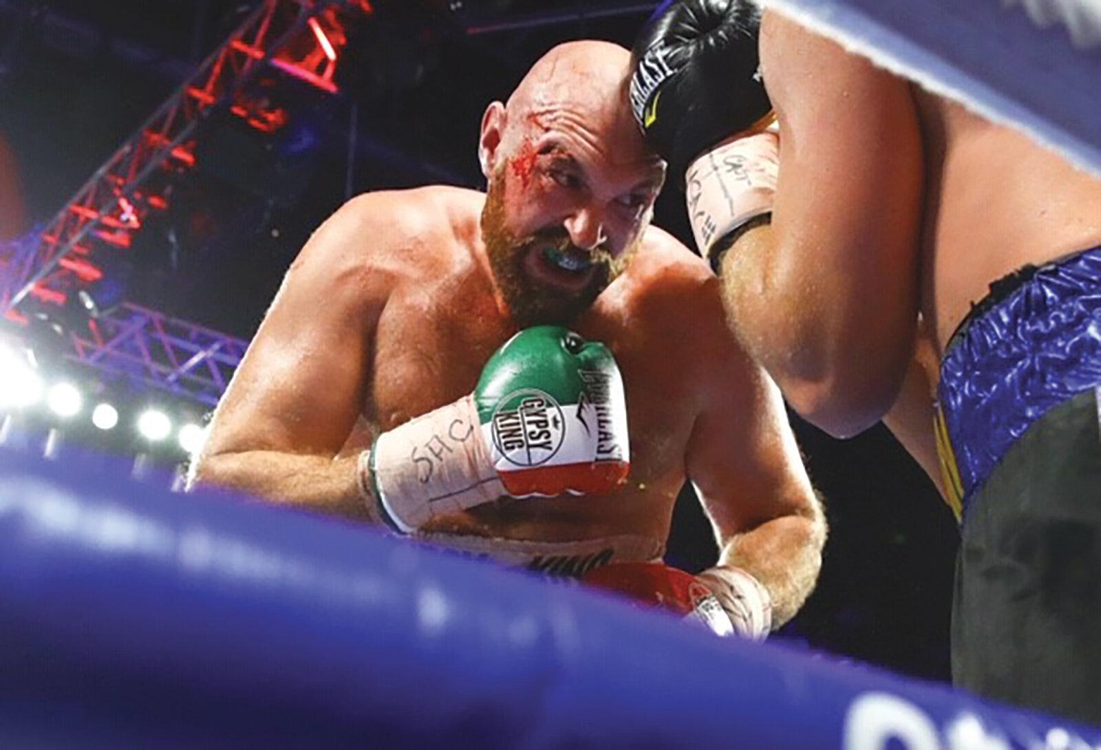 Fury Overcomes Comes Nasty Cut to Beat Wallin pic 2.jpg