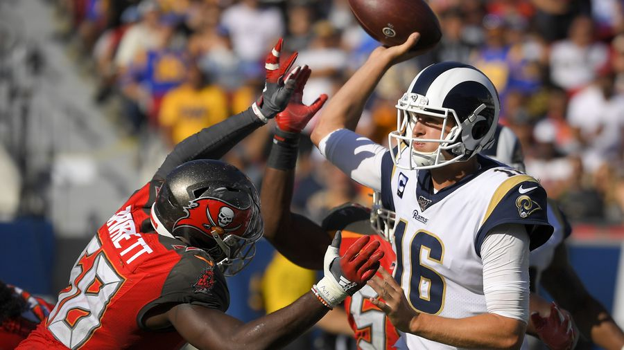 Los Angeles Rams quarterback Jared Goff, right, passes under pressure from Tampa Bay Buccaneers linebacker Shaquil Barrett during the second half of an NFL football game Sunday, Sept. 29, 2019, in Los Angeles. [MARK J. TERRILL | AP]