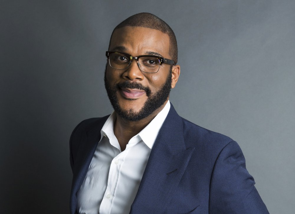 FILE - In this Nov. 16, 2017, file photo, actor-filmmaker and author Tyler Perry poses for a portrait in New York. Perry says his massive Atlanta-based studio will rival other major Hollywood studios for years to come. The actor-director-writer is planning to unveil his Tyler Perry Studios during a star-studded grand opening Saturday. The 330-acre studio is considered one of the largest studios in the country with 12 sound stages, 40 buildings onsite that are listed on the National Register of Historic Places and over 200 acres of green space.(Photo by Amy Sussman/Invision/AP, File)