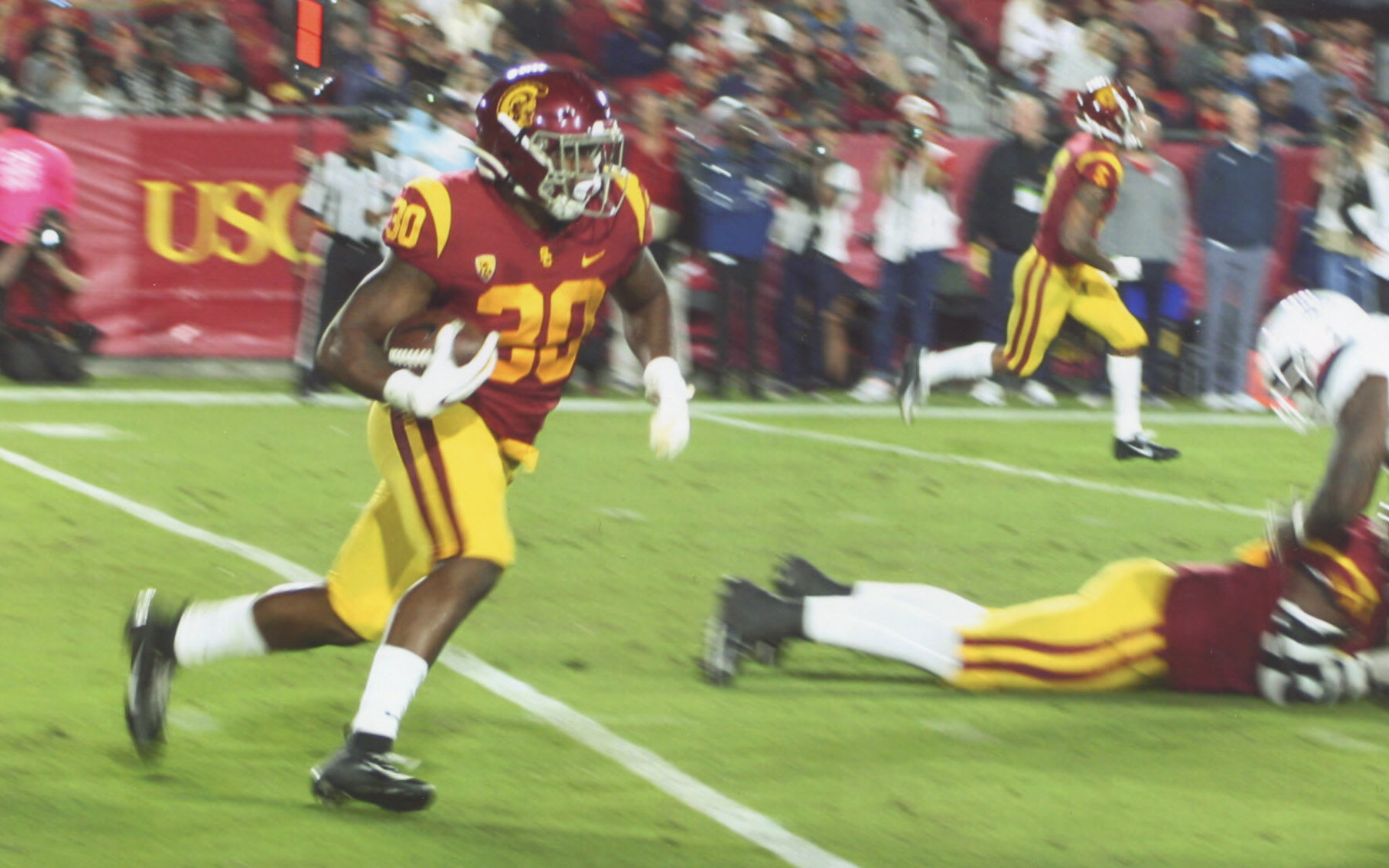 Markese Stepp (30) Runs for some of his 66 yards on 13 carries. (Earl Heath Photo)