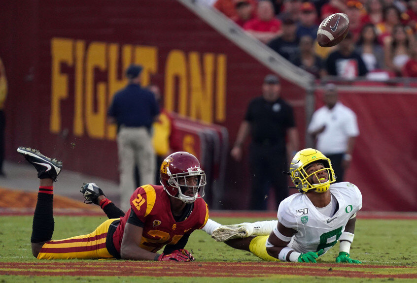 USC Trojans wide receiver Tyler Vaughns #21 and Oregon Ducks safety Jevon Holland #8 try to grab a tipped pass at the Los Angeles Memorial Coliseum on Saturday, Nov. 2, 2019. (Photo by Scott Varley, Daily Breeze/SCNG)