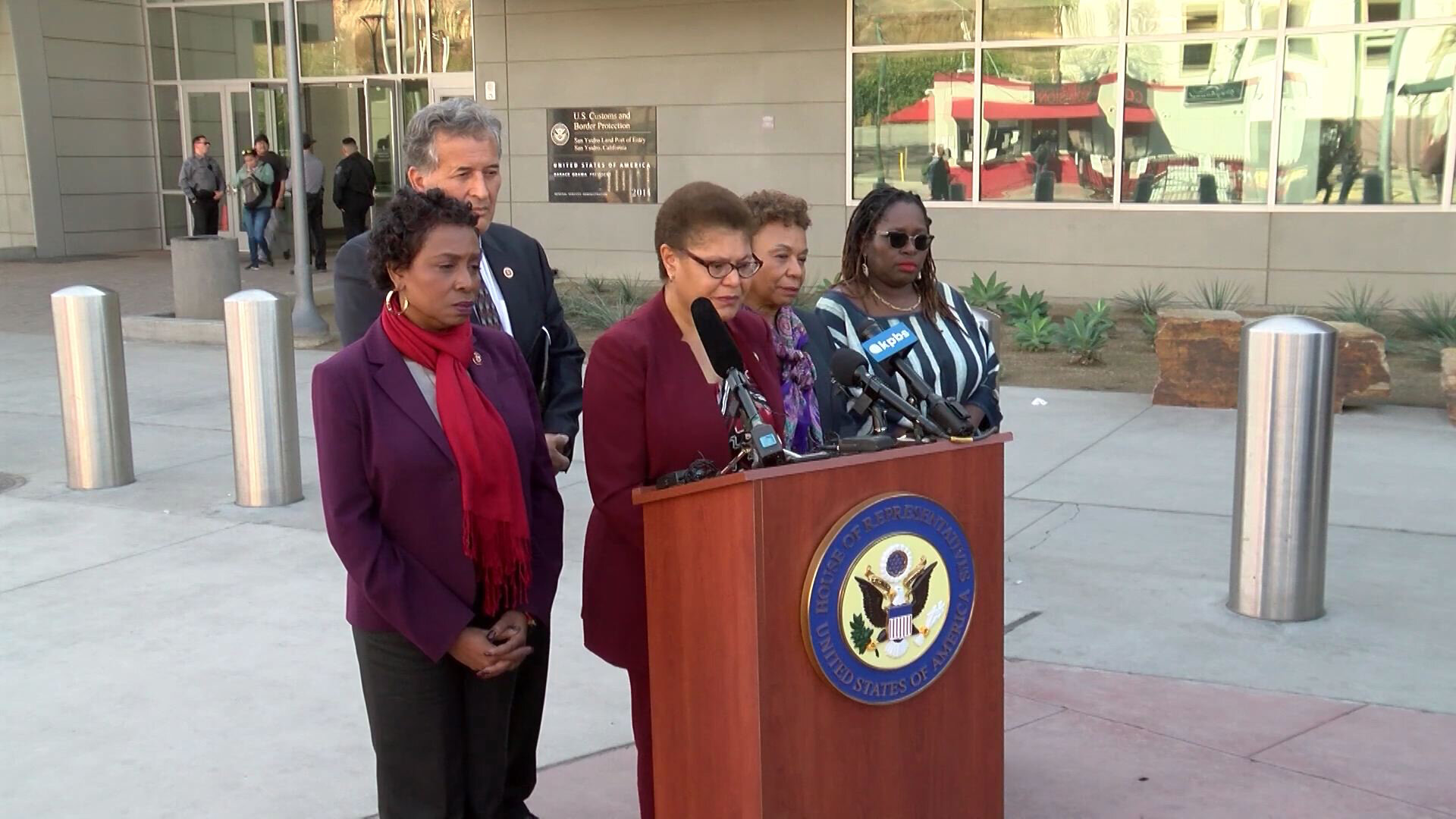 Members of the Congressional Black Caucus, Rep. Karen Bass (D-CA) (center), Rep. Barbara Lee (D-CA) (fourth from left), and Congresswoman Yvette Clarke (D-NY) (far left), along with local Congressman, Rep. Juan Vargas (second from left), visited a shelter for African asylum-seekers in Tijuana November 22, 2019. Attorney Nana Gyamfi, the executive director of the Black Alliance for Just Immigration (far right), joined the group at the border. (Photo: Screen capture KPBS / YouTube)