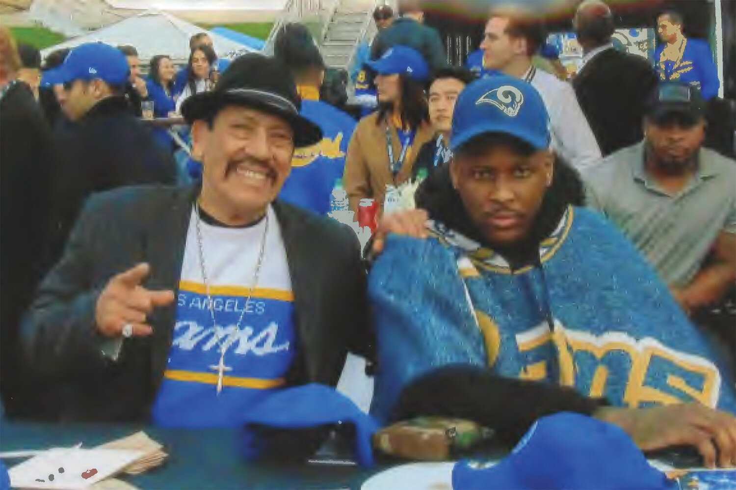 Actor Manny Trejo and Rapper YG at take in Rams win at the Coliseum final game. (Earl Heath Photo)