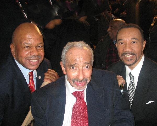 Three generations of Maryland's 7th District Congressmen (Congressman Elijah E. Cummings, 1996 to present; former Congressman Parren J. Mitchell, 1971 to 1987; and former Congressman Kweisi Mfume, 1987 to 1996) attend the ceremony officially designating the facility of the U.S. Postal Service located at 6101 Liberty Road in Baltimore, Maryland, as the U.S. Representative Parren J. Mitchell Post Office. (January 2007) (Photo: Office of Congresssman Elijah Cummings / Wikimedia Commons)