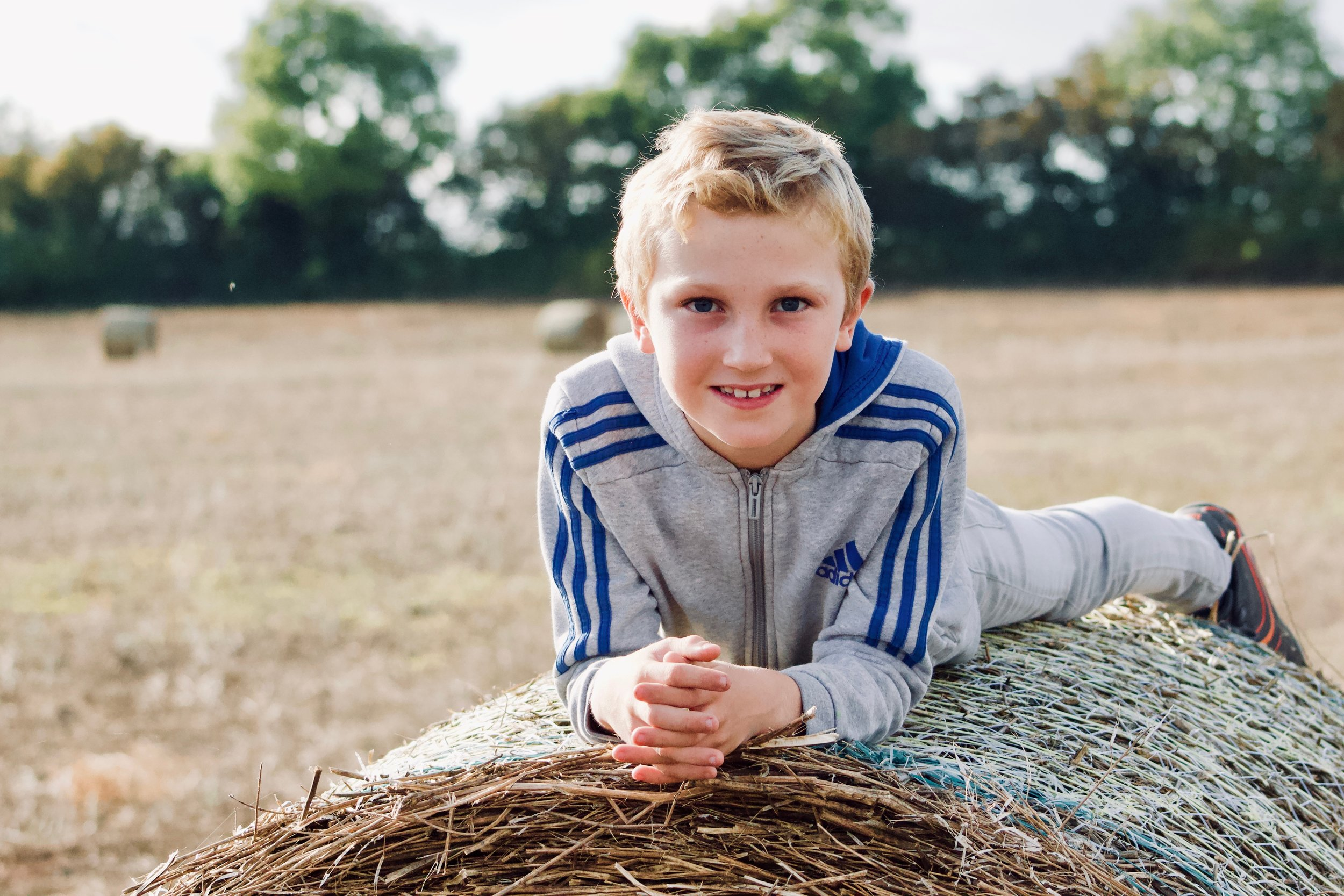 My eldest happily posing in a local crop field, South Gloucestershire.