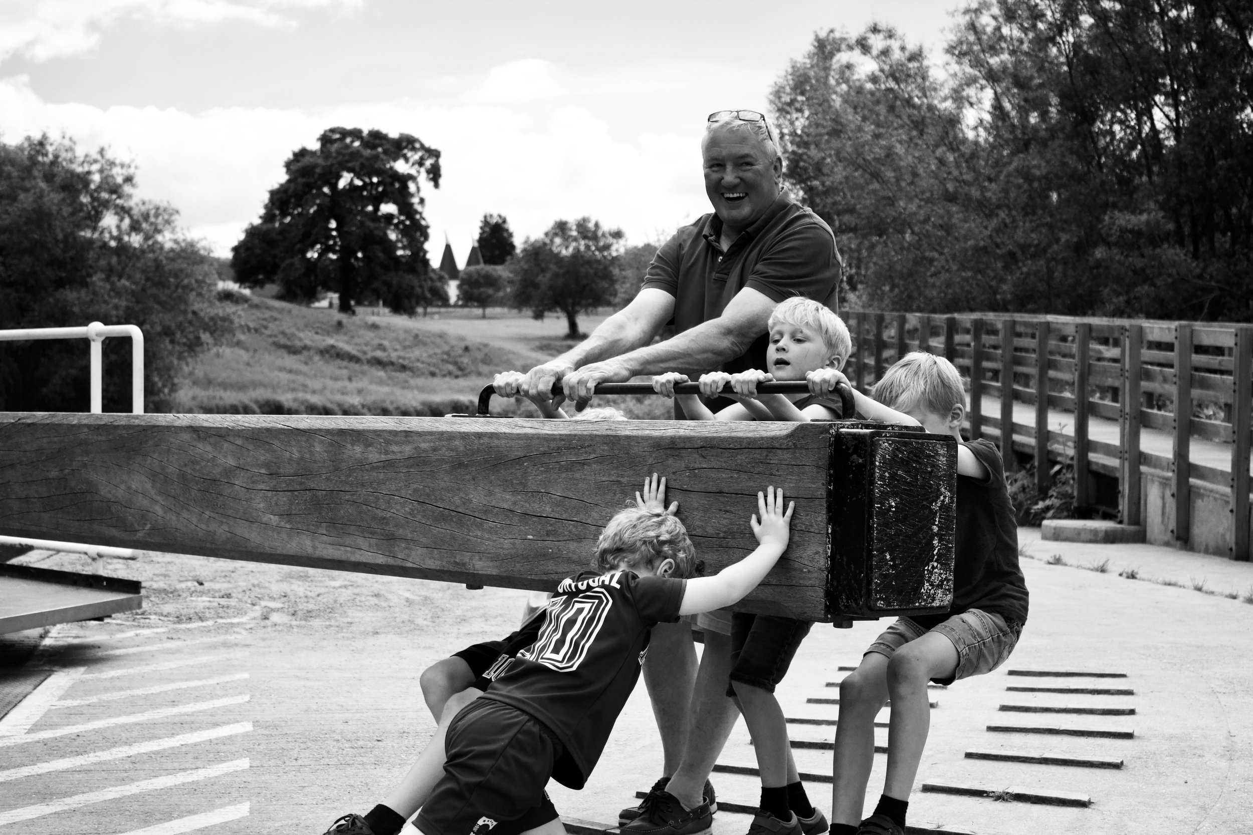 photo of family playing outdoors