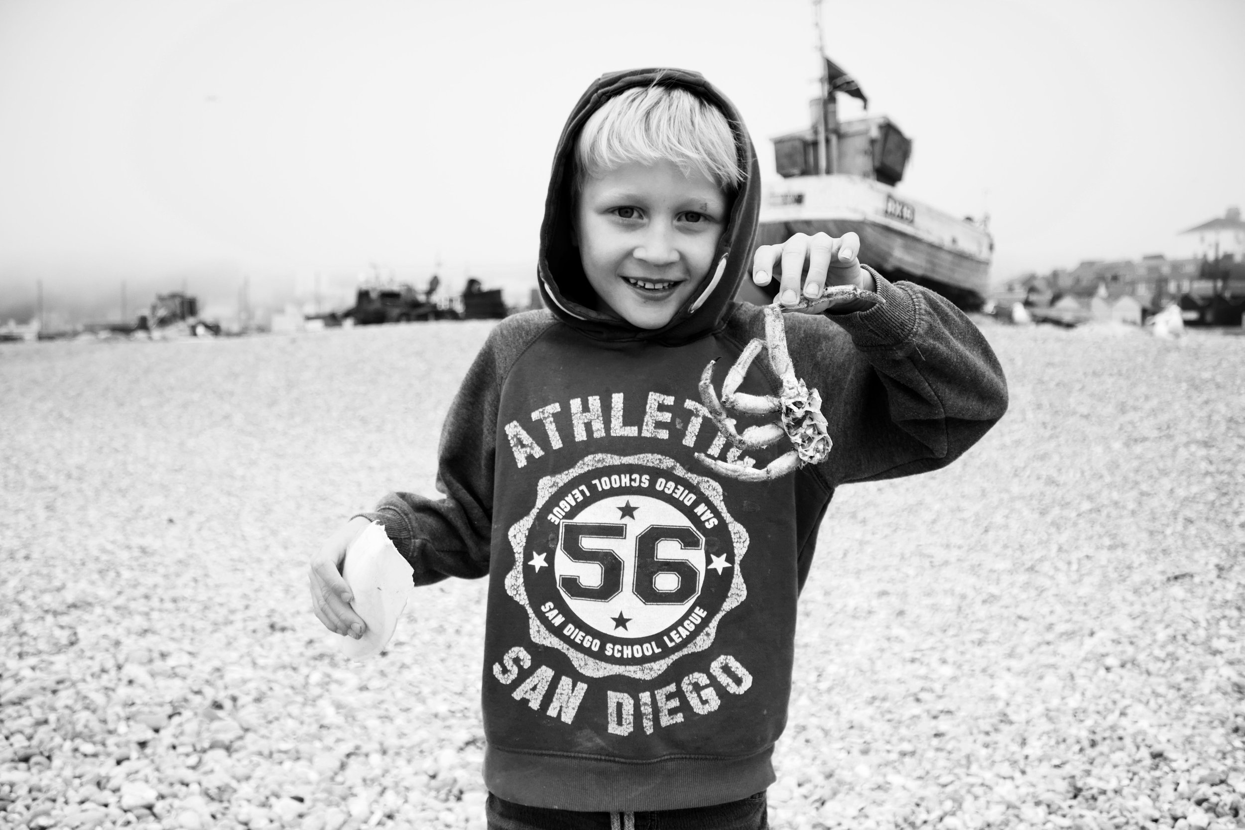 black and white photo of child on beach