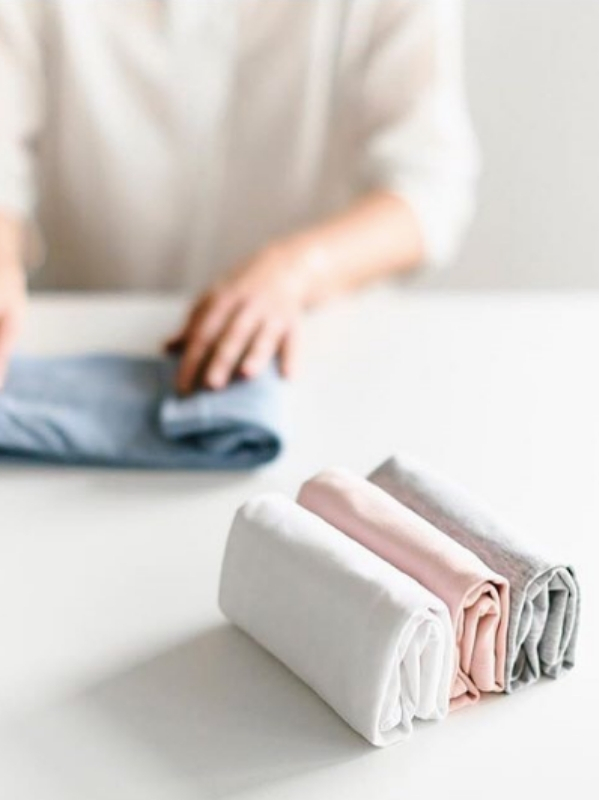 Above: The KonMari folding method. If it doesn't fall over when you remove your hand, it has passed the folding test. | Source:  @mariekondo