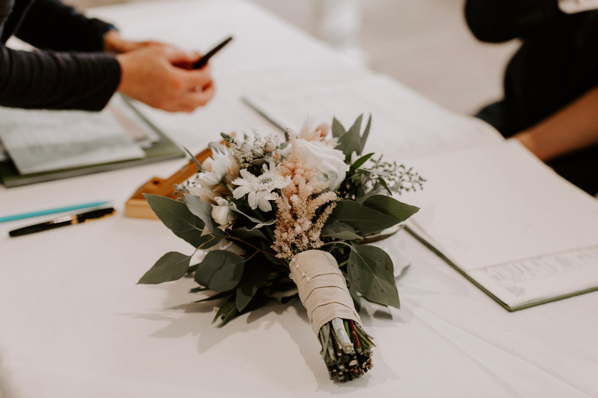AB bride bouquet on table.jpg