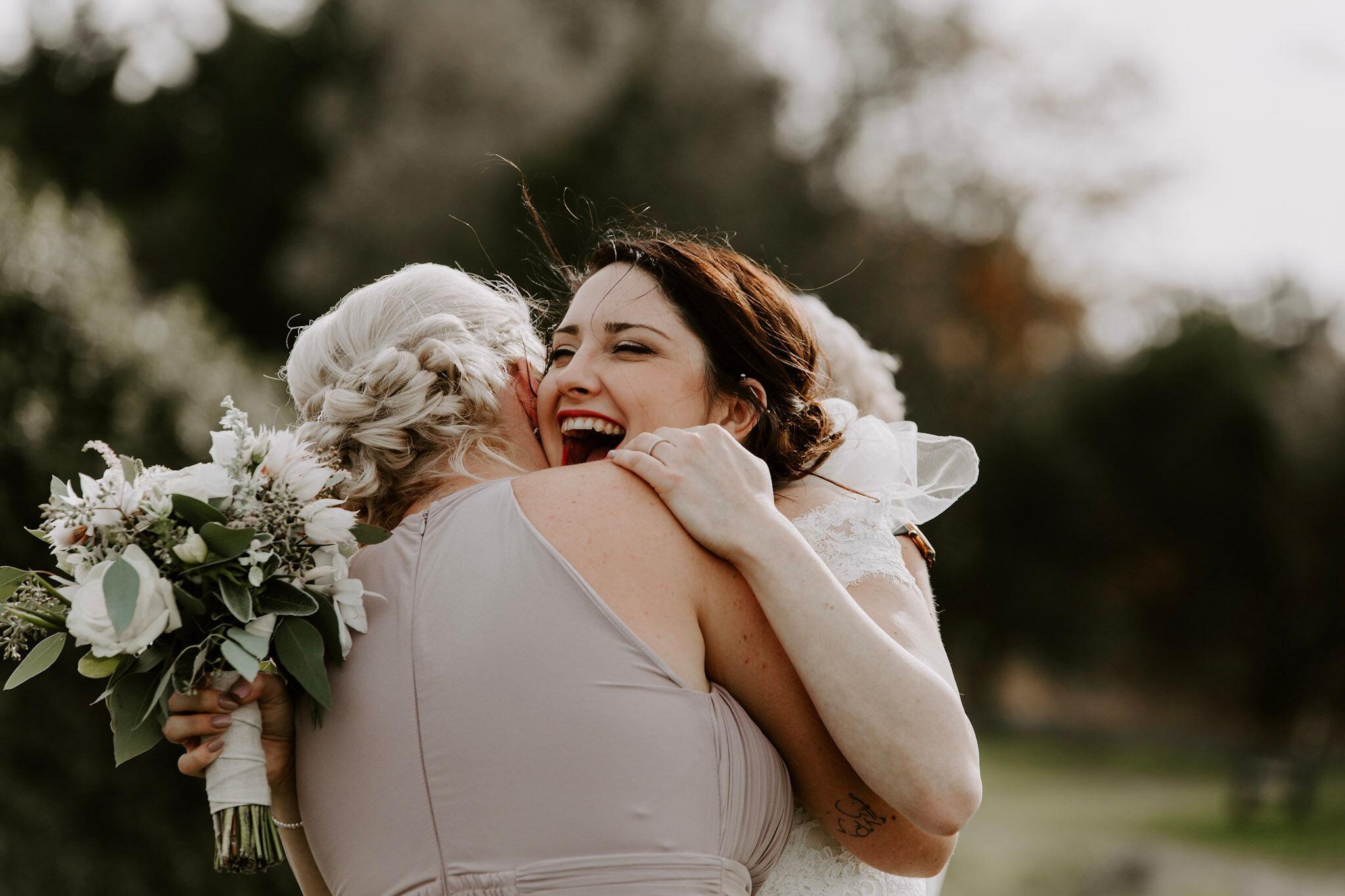 AB bride hug and bouquet.jpg