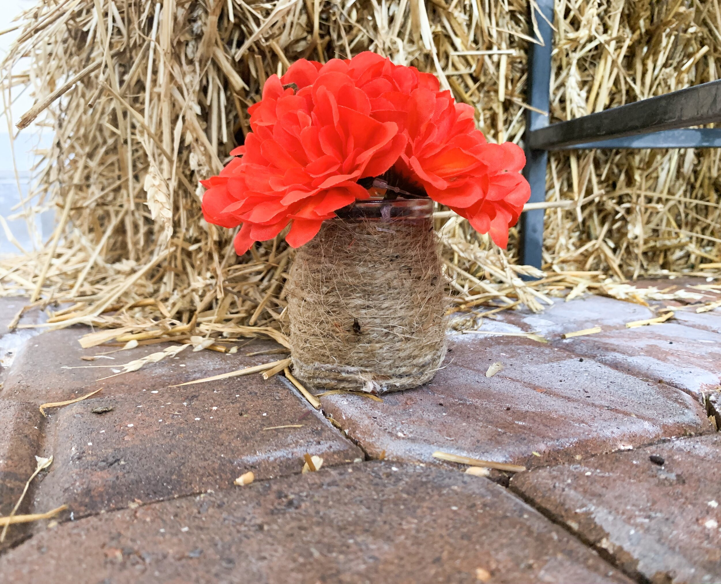 Twine wrapped vases with red flowers $2.50 @ Old Time Pottery
