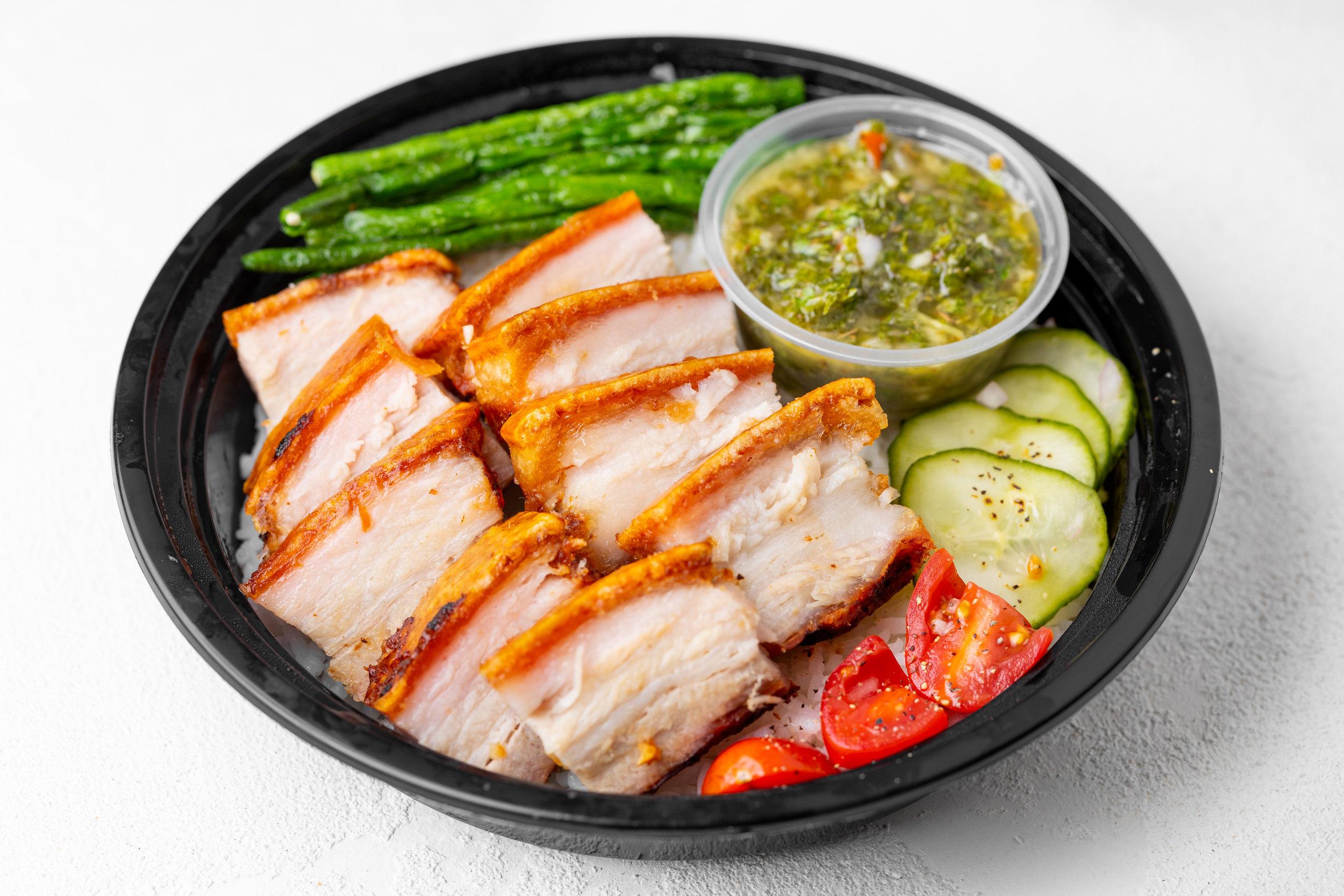 Lechon Kawali - Oven-crisped pork, pickled cucumber.Your choice of: homemade apple sarsa or market citrus chimichurri