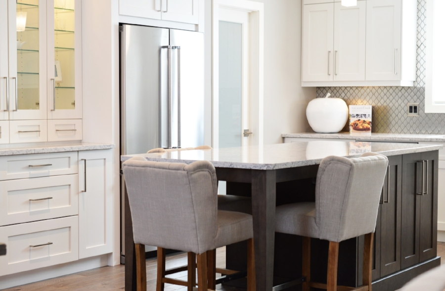 Clear the countertops! Put away the toaster, mixer, everything. The buyer needs to visualize themselves in this environment, which is easier to do without your small appliances.