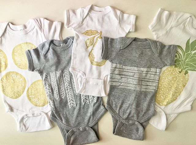 We are busy making tons of different onesies because once I started printing them I couldn't stop! Everything is cuter on a tiny human. We will be debuting these at @porterflea at the end of the month. They'll be appearing on our Etsy shop around the same time. Stay tuned for little beets and carrots 🥕🥕🥕