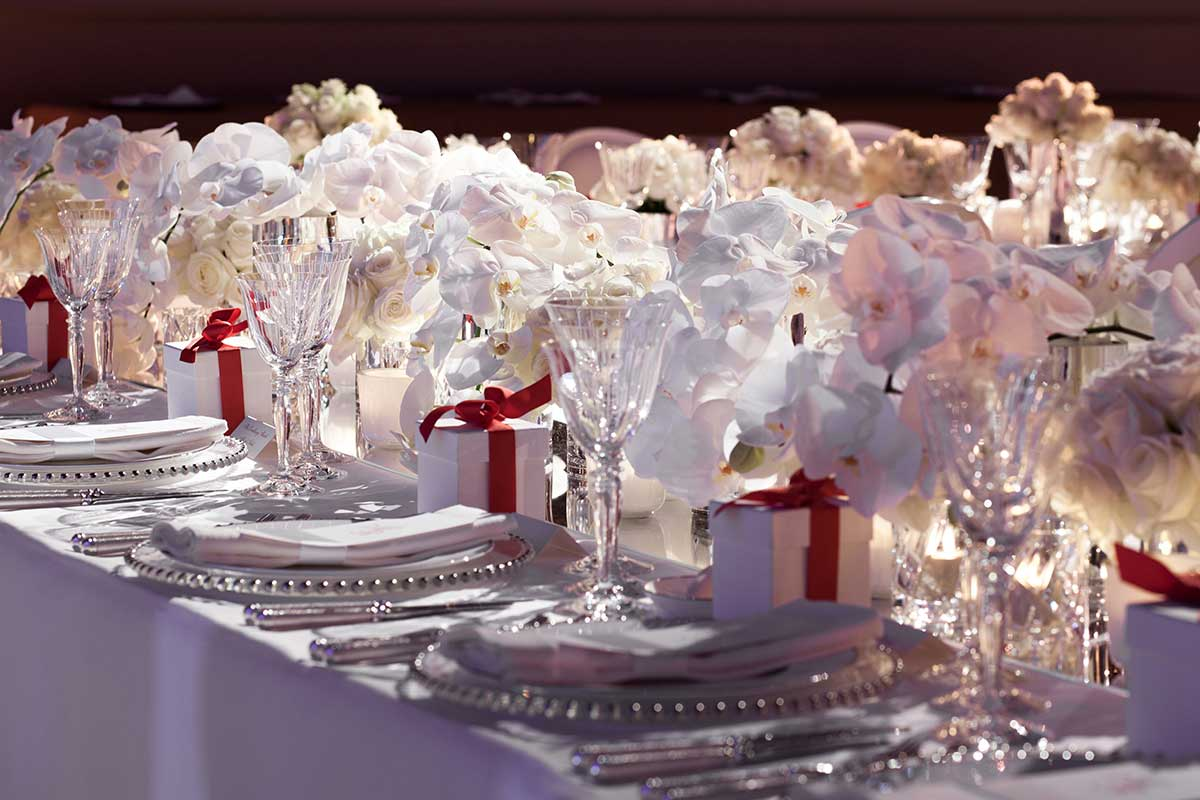 Nikki Tibbles Wildatheart Tablescape white table settings with white orchids