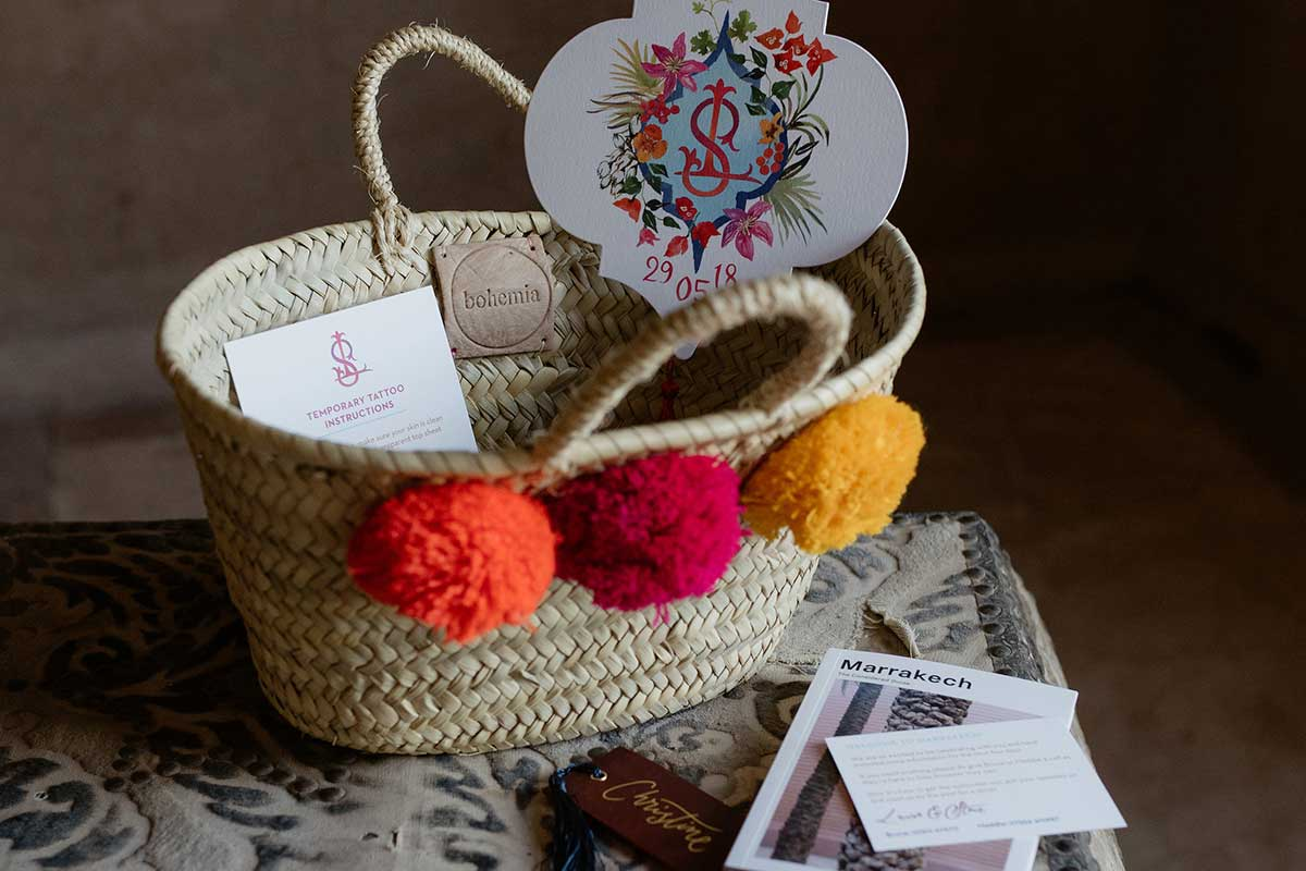 wedding stationery welcome baskets Marrakech woven basket with colourful pompoms