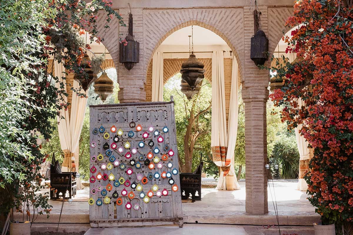 Escort card display marrakech wedding pompom