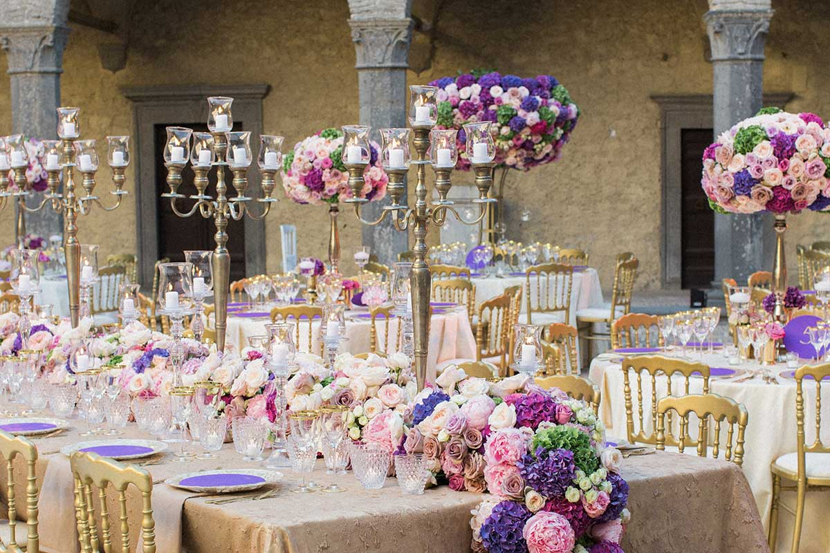 Top table-wedding tablescape with purple and pink floral decoration