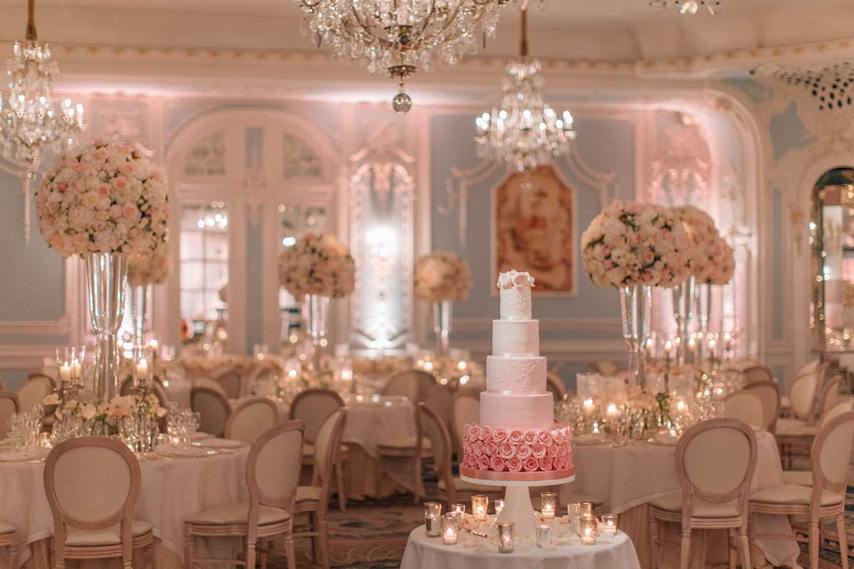 White tiered wedding cake in the ballroom at the Savoy London