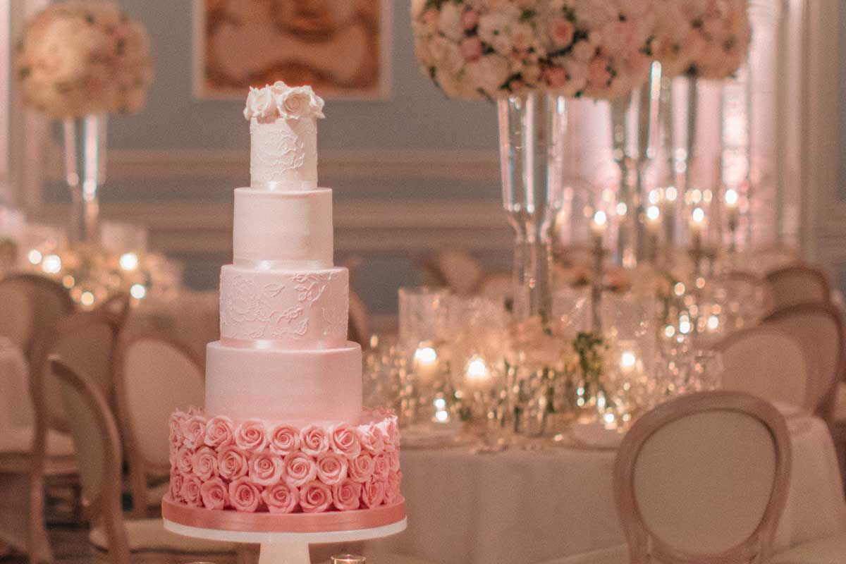 Five-tiered wedding cake with pink roses decoration