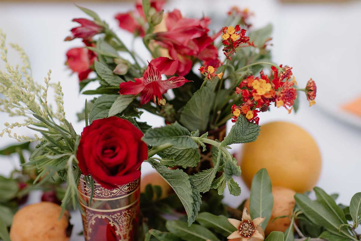 Red roses floral arrangement in Moroccan style vase