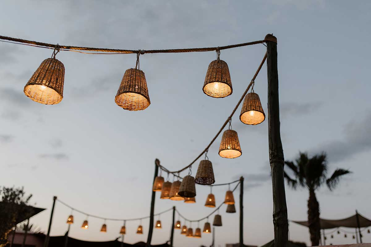 Hanging rattan lights Marrakech Moroccan style rooftop dinner El Fenn
