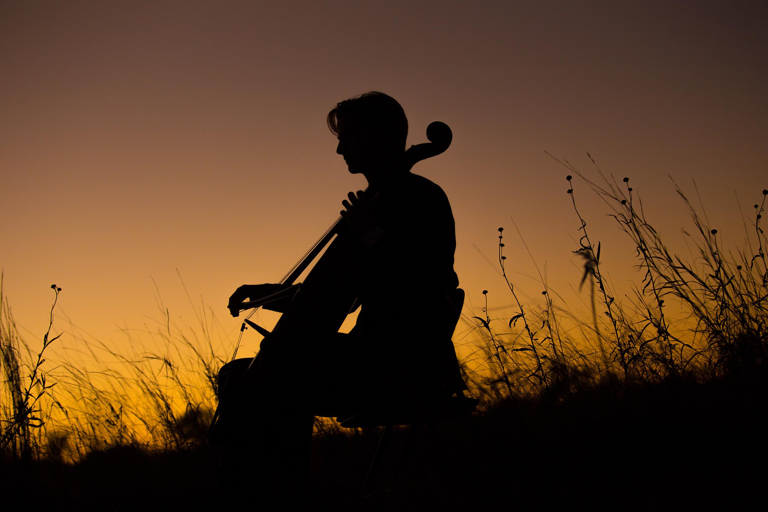 Senior-boy-orange-sunset-silhouette-playing-cello.jpg