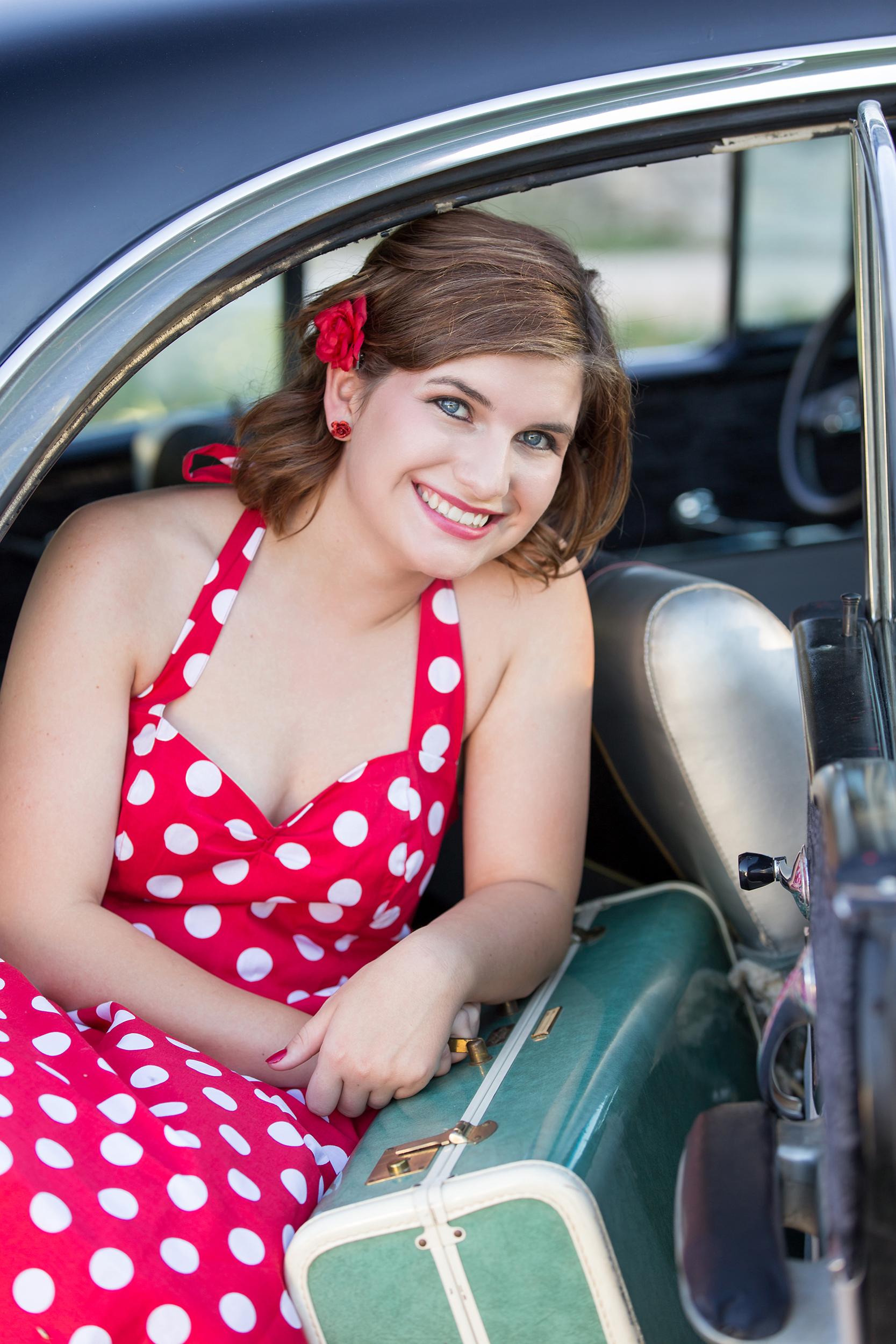Senior-girl-vintage-car-suitcase-red-polkadot-dress.jpg
