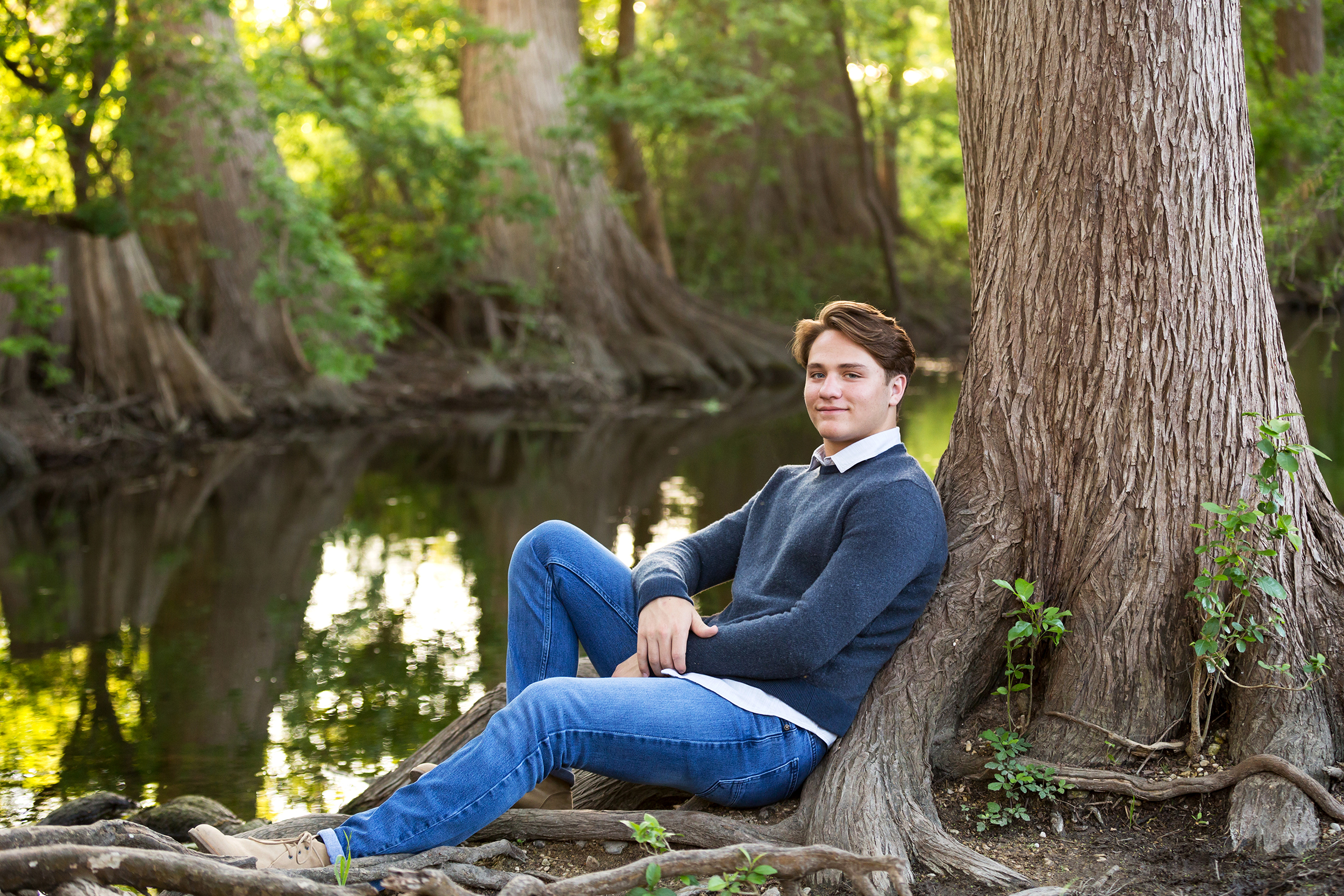 Teen-boy-river-sitting-treeroots.jpg