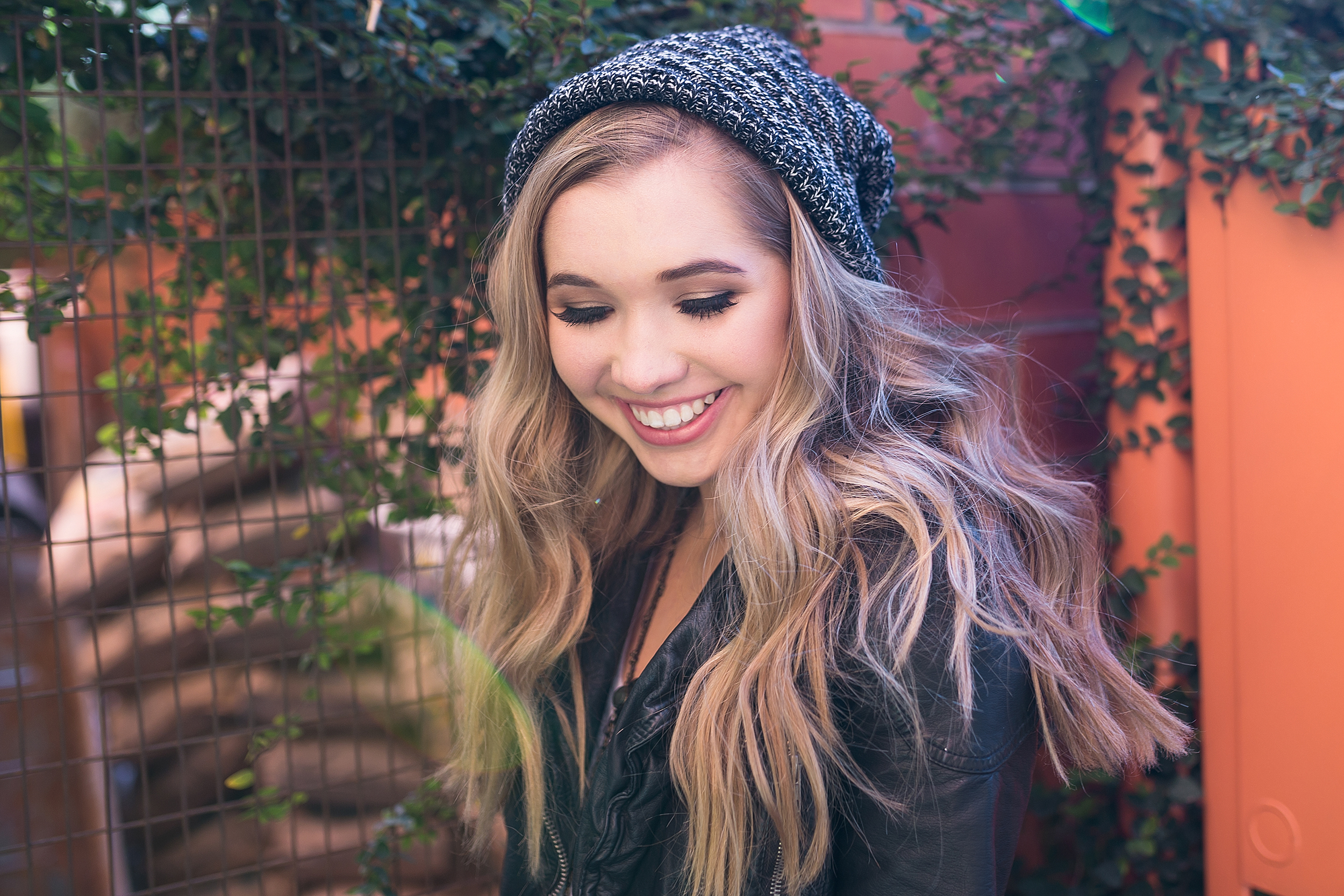 Teen-girl-black-jacket-beanie-hat.jpg