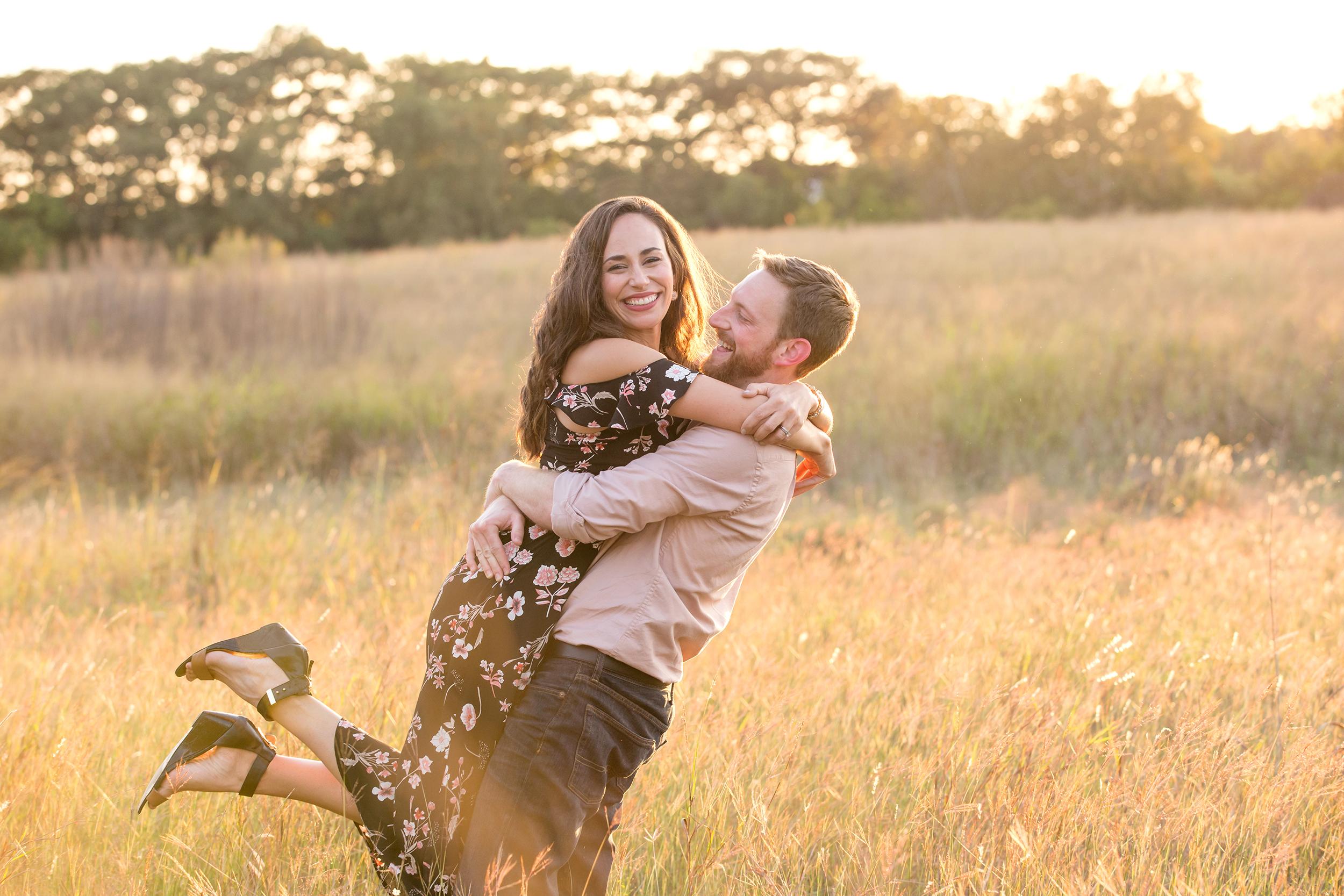 Couple-grass-field-smiling-hugging.jpg