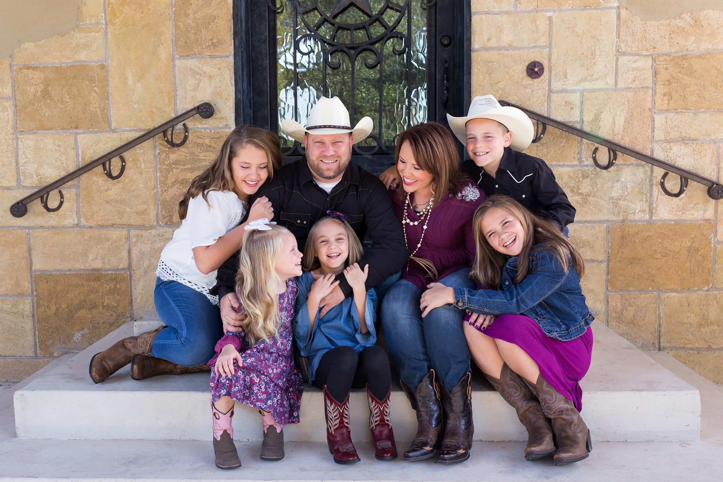 Family-sitting-porch-hugging-laughing.jpg