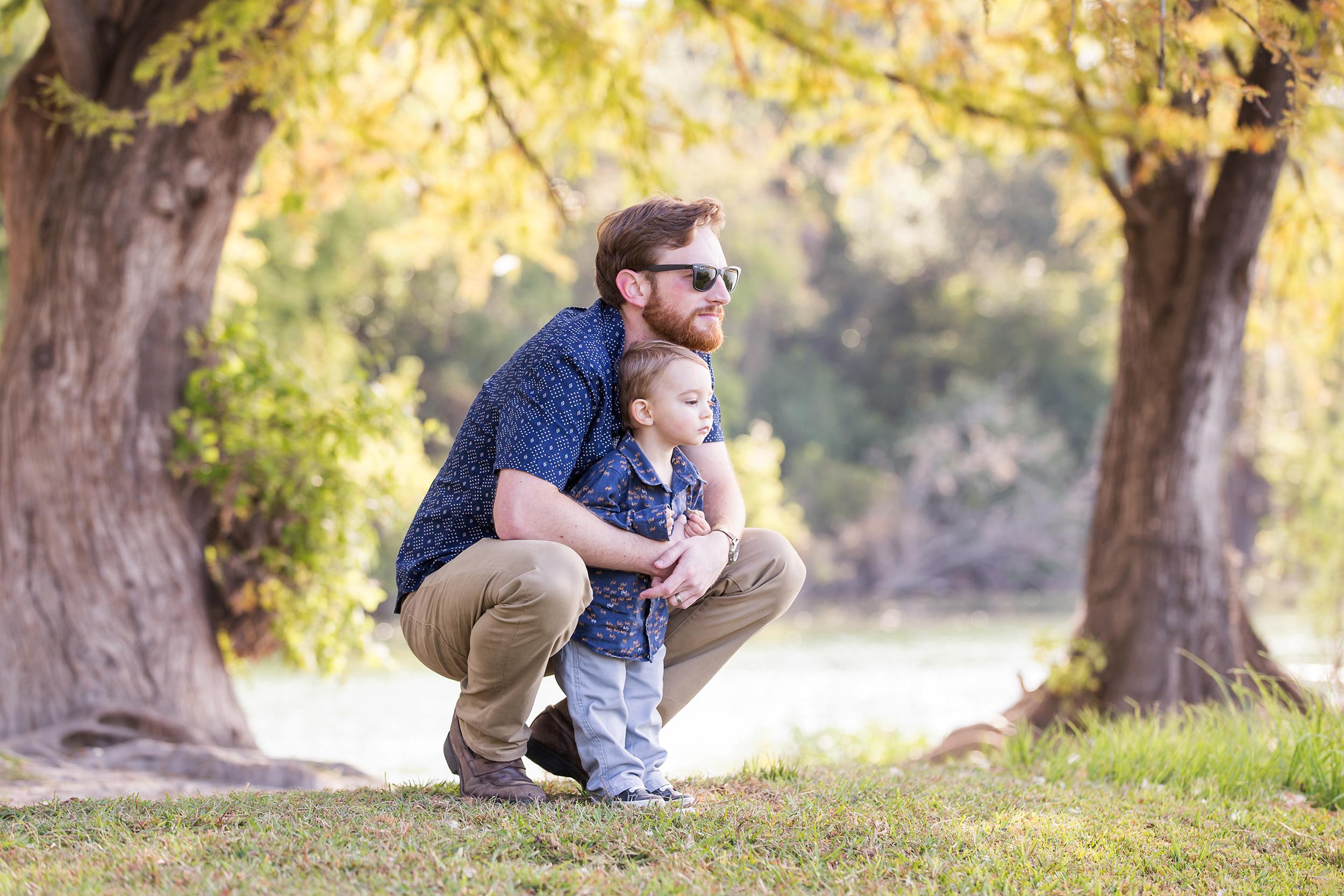 Father-toddler-son-hugging-river-park.jpg