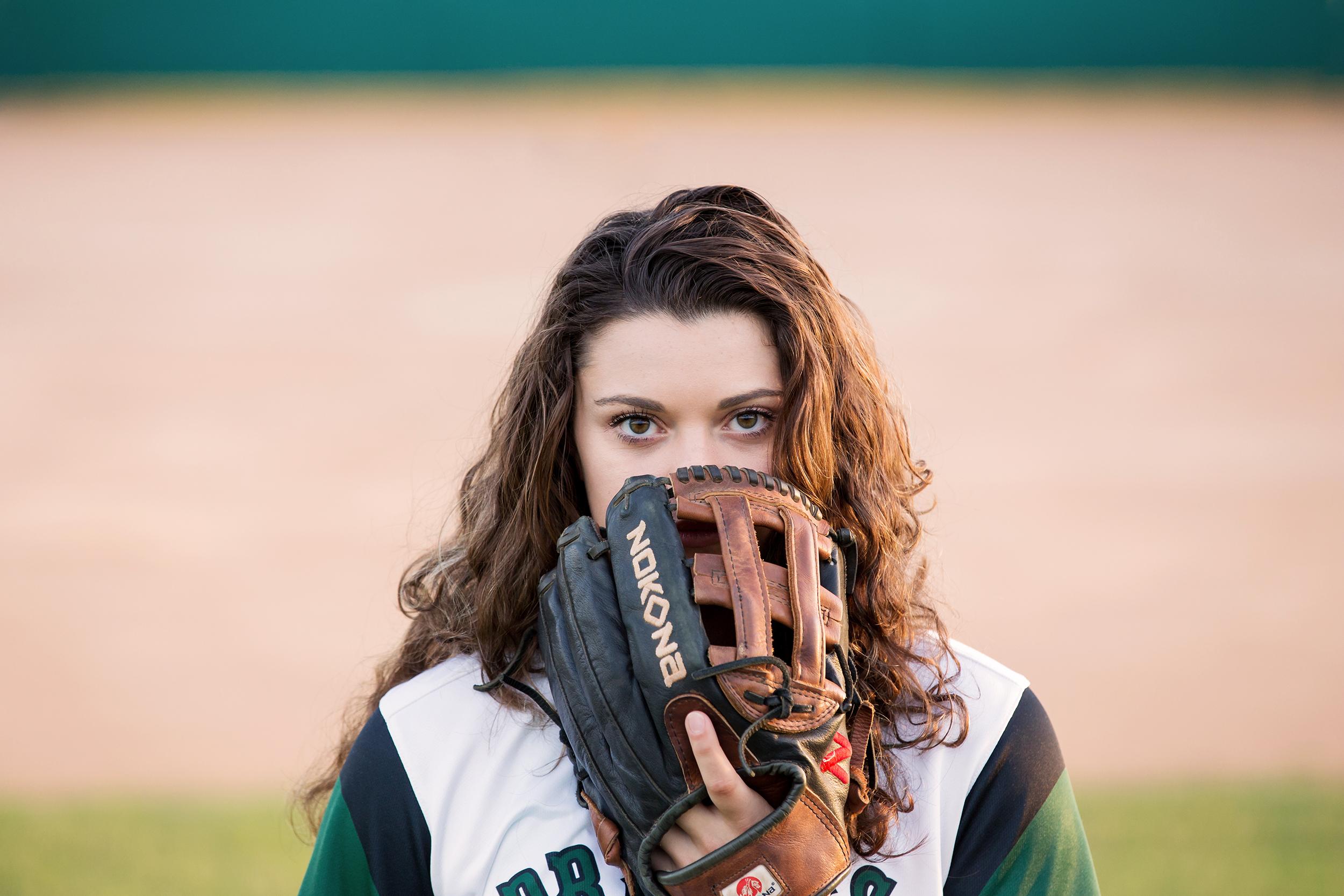 Senior-girl-softball-glove-eyes-field.jpg