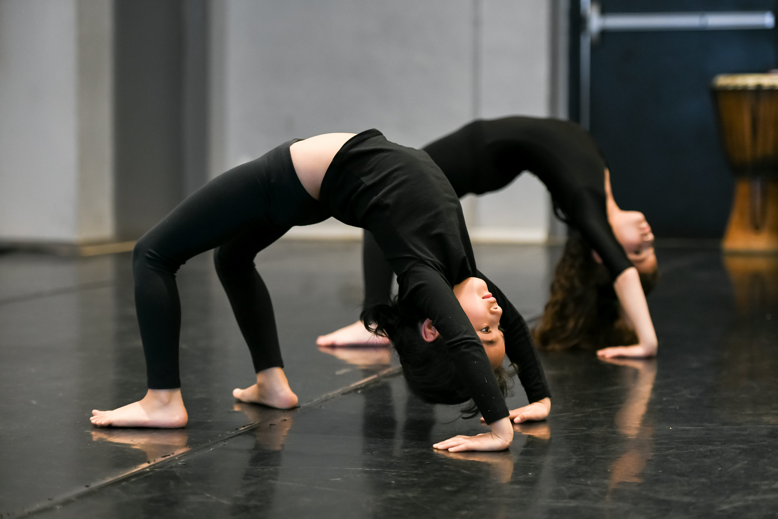 ACRO - Acro dance is a style of dance that combines classical technique with acrobatics. Students develop a strong foundation which increases their flexibility and strength while working on musicality and acrobatics such as tumbling, cartwheels, bridges and more