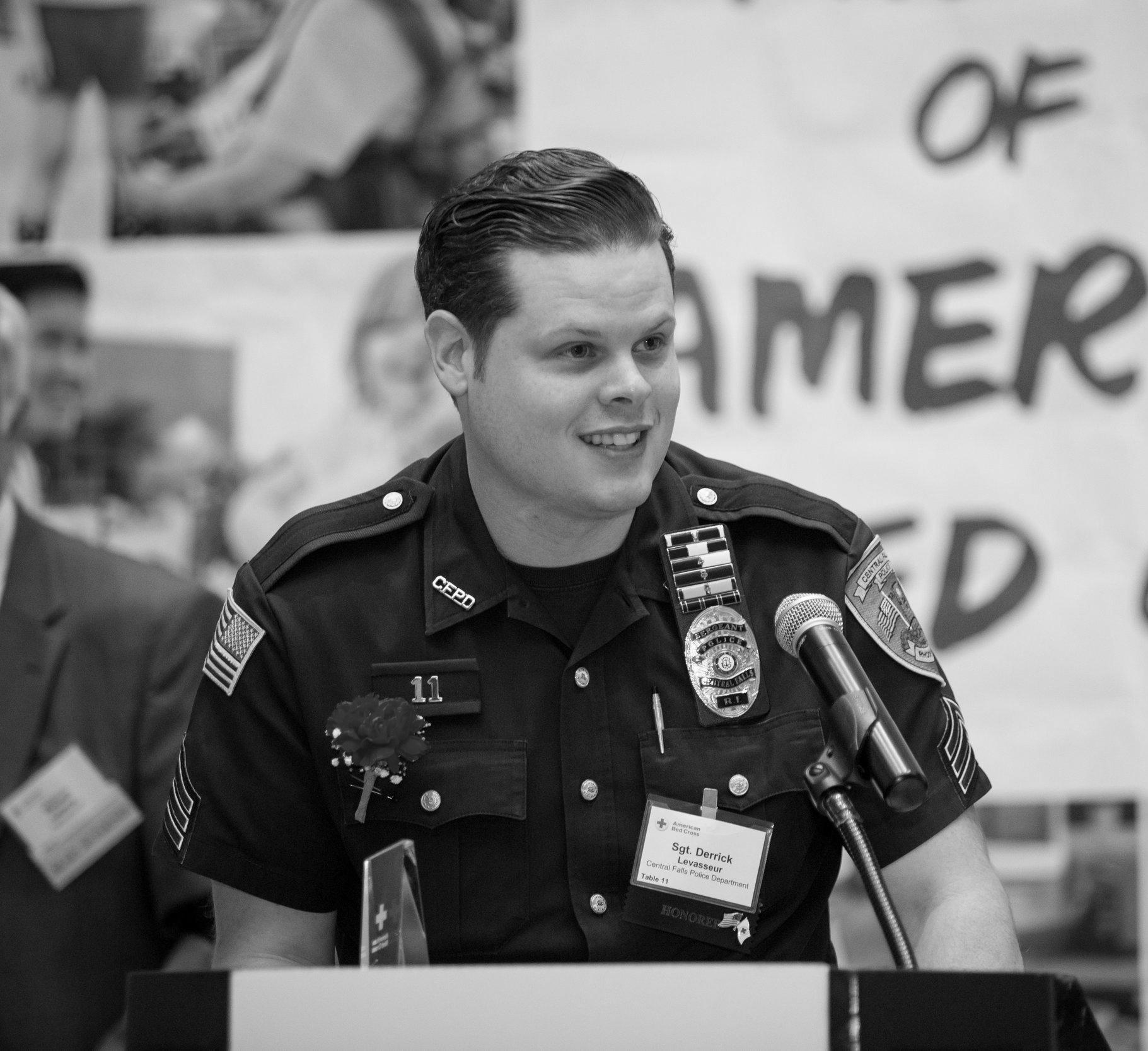 """Derrick giving a speech after receiving the 2017 American Red Cross """"Hero Award."""""""