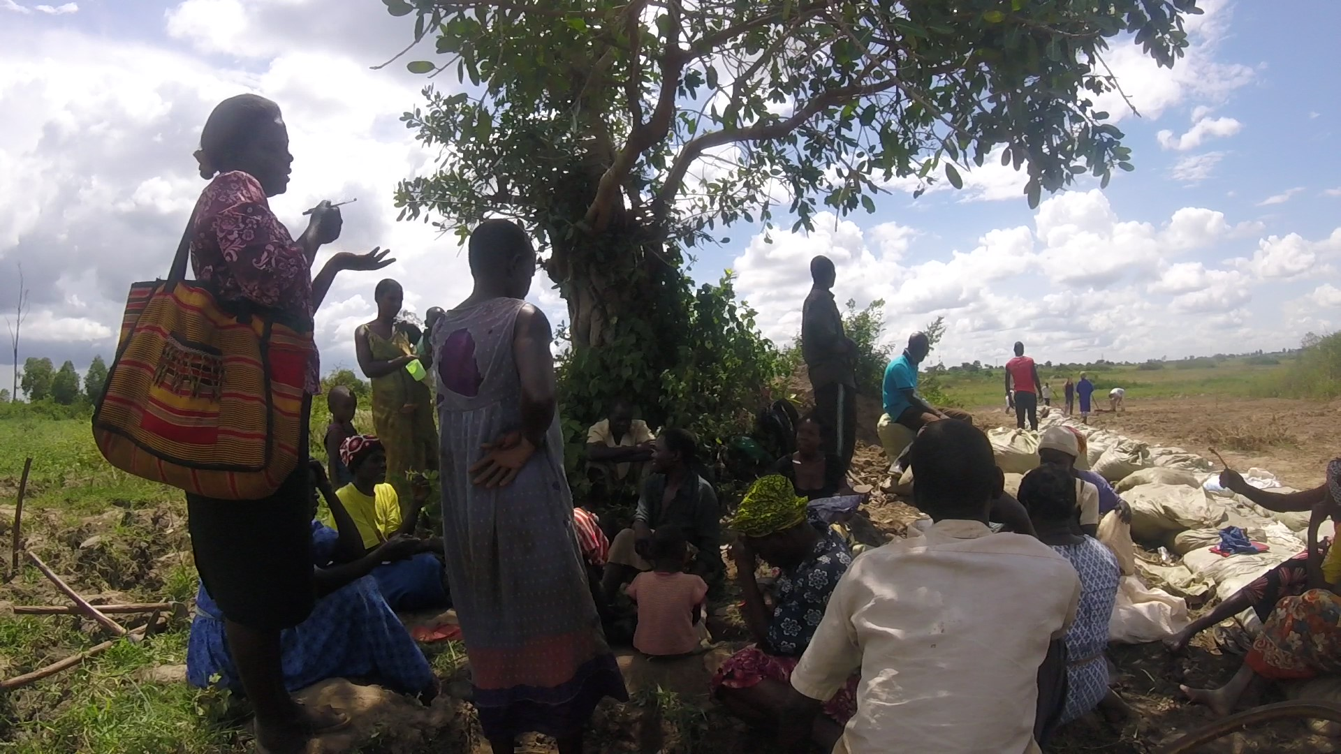 Helen Acuku (left) facilitates a group discussion during a group field work day at Aloet.