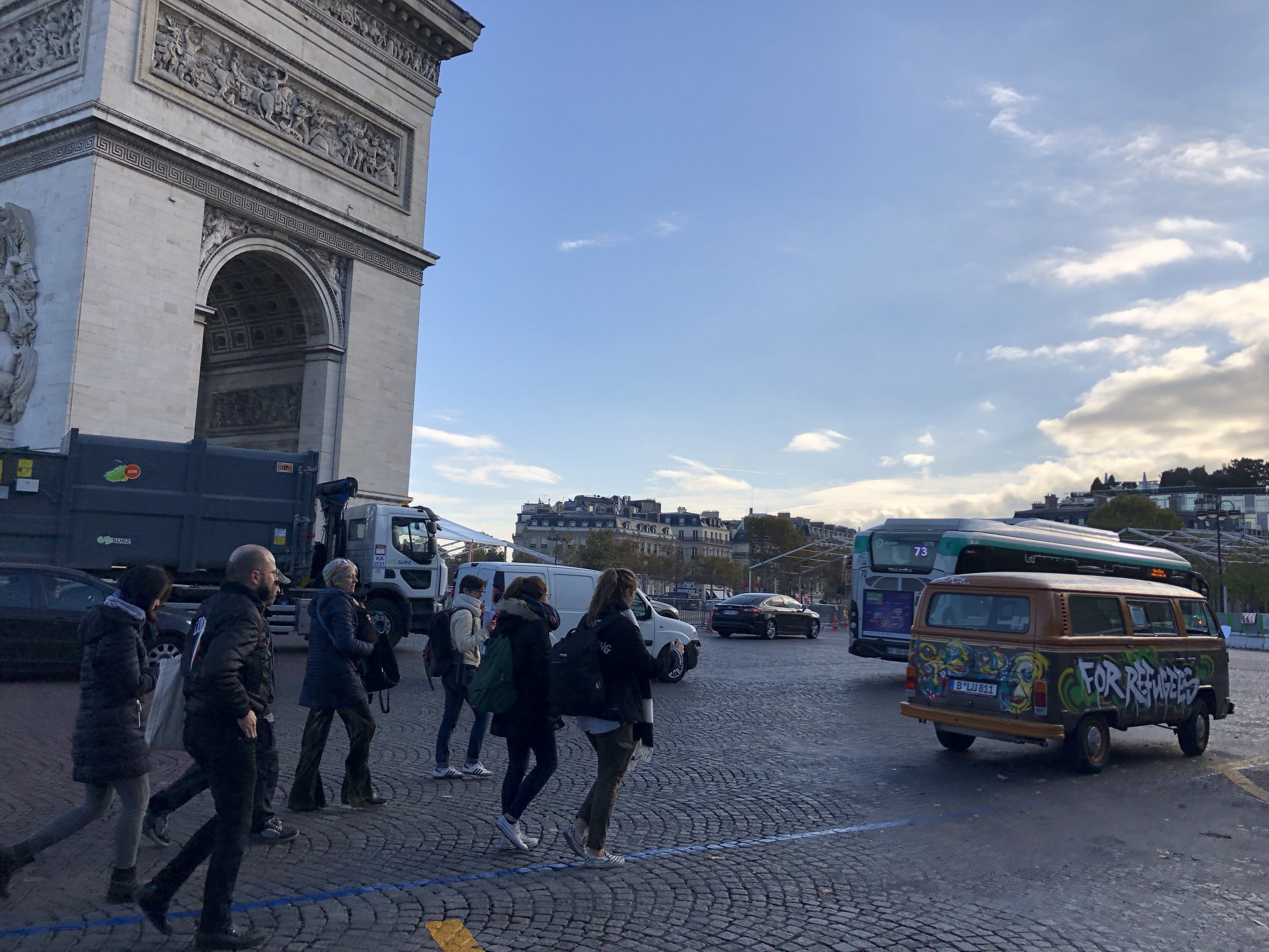 Friends at Arc de Triomphe with vw bus.JPG