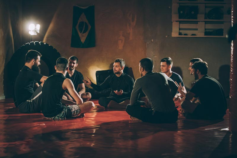how-bjj-works-grapplers-discuss-how-the-class-went-iStock-946549614.jpg