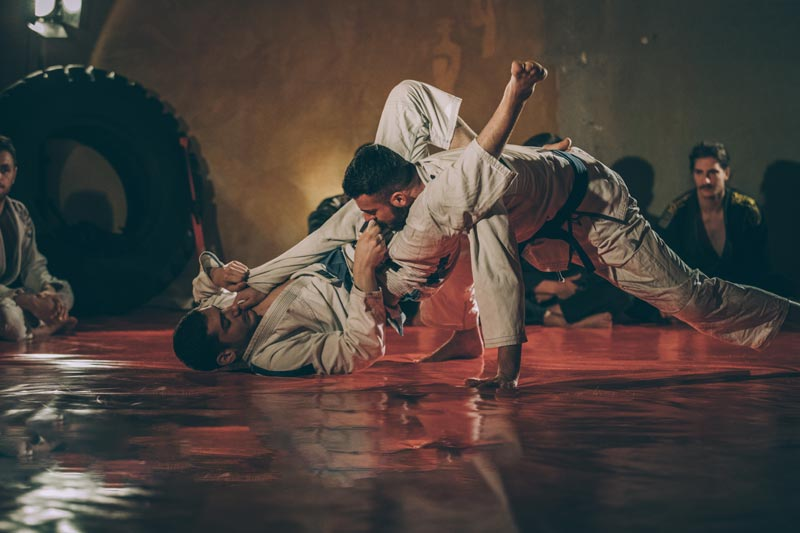 how-bjj-works-man-sets-up-bjj-triangle-submission-iStock-925615508.jpg