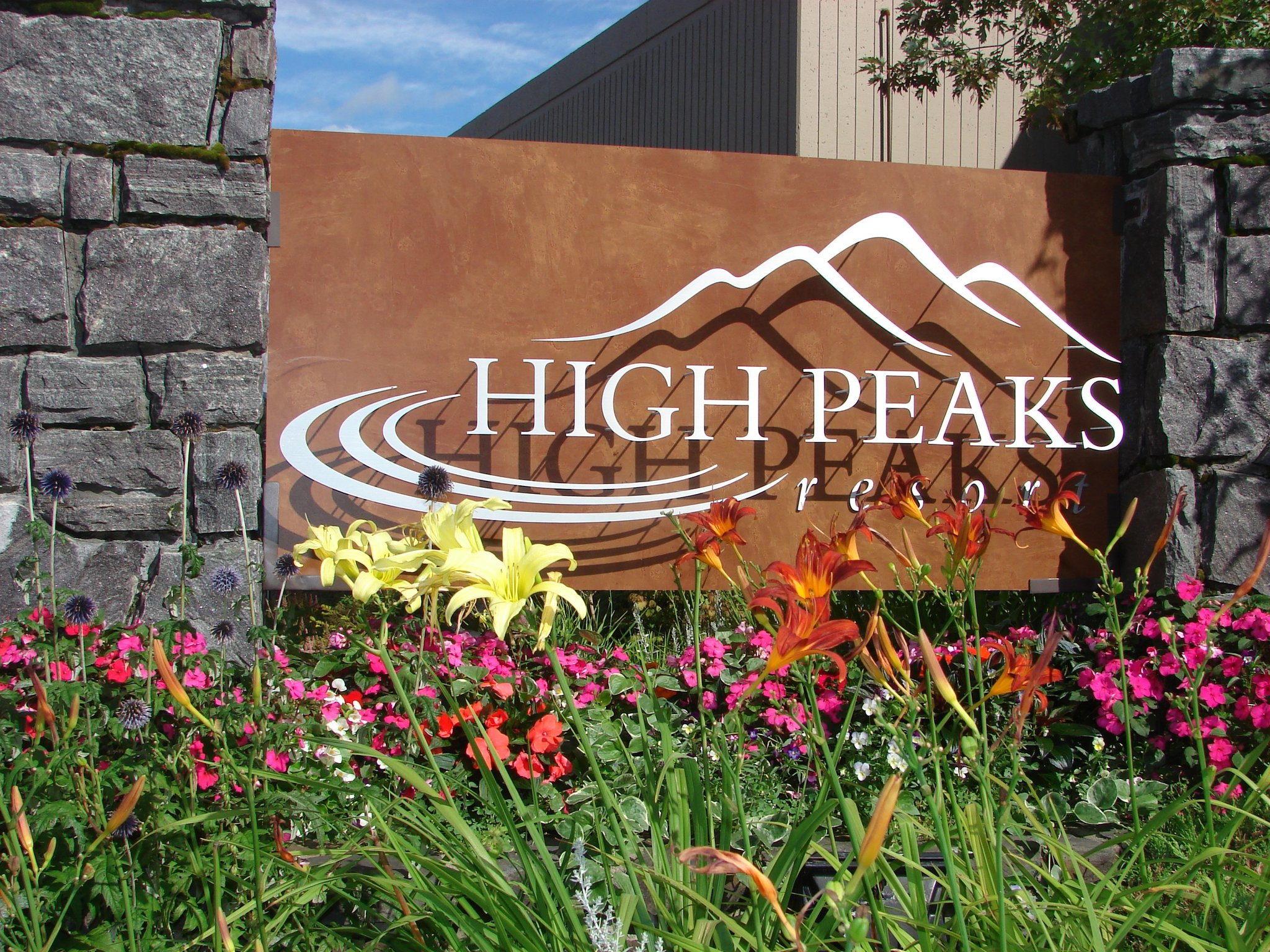 High Peaks Resort sign with flowers.jpg