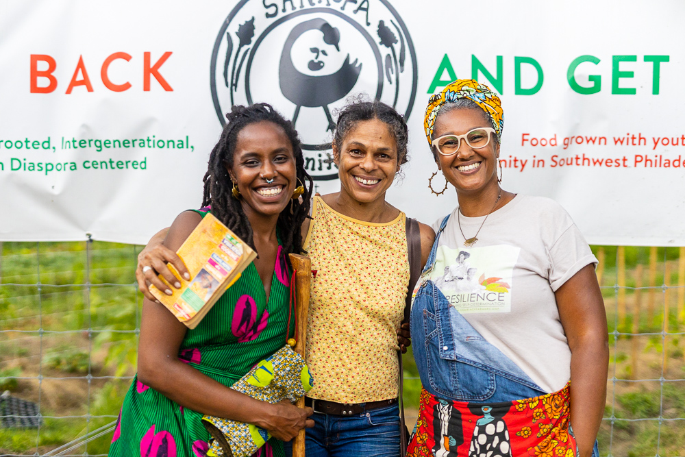 Our Mothers' Kitchens (OMK) founders, Khaliah D. Pitts (l) + Shivon Love (r) with Chandra Brown, daughter of OMK Foremother, Vertamae Smart-Grosvenor. Photo by Gabrielle Clark