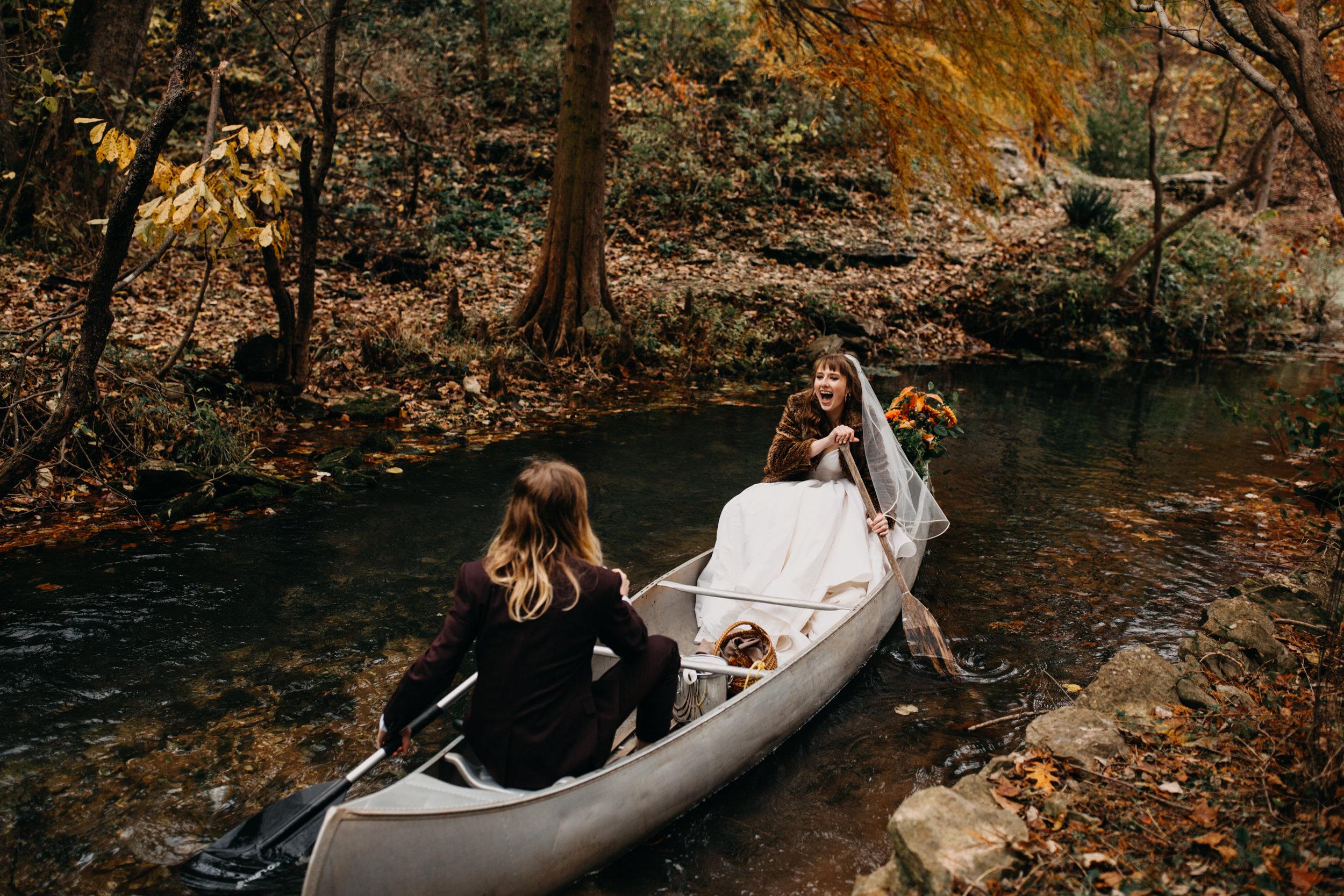 wedding getaway canoe flowers