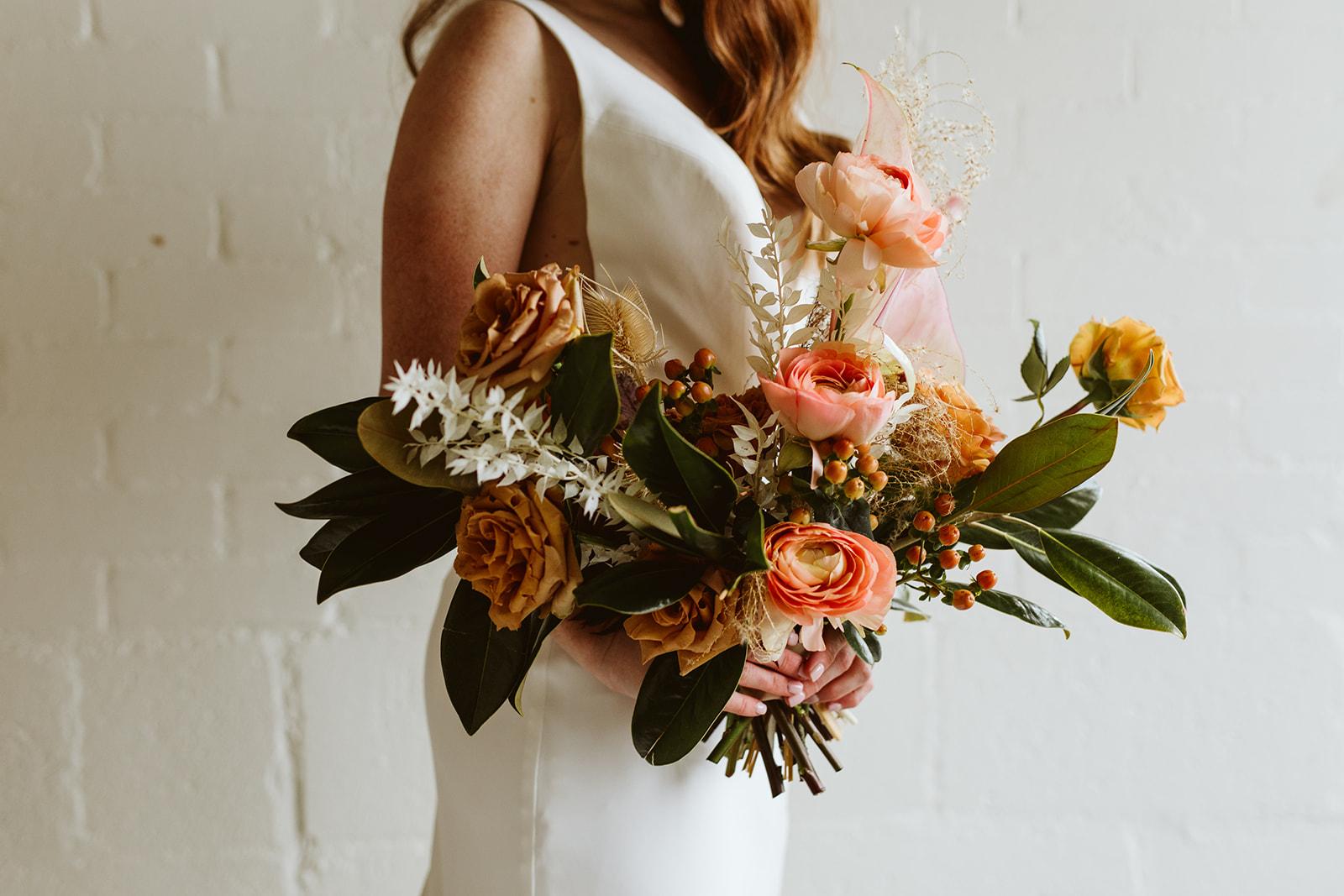 boho bouquet. boho bride. boho wedding. asymmetrical bouquet. wildflower bouquet. rose bouquet. airy modern wedding. bright wedding. natural wedding. peach wedding color. pink wedding color. peach flowers. blush wedding. eclectic wedding.