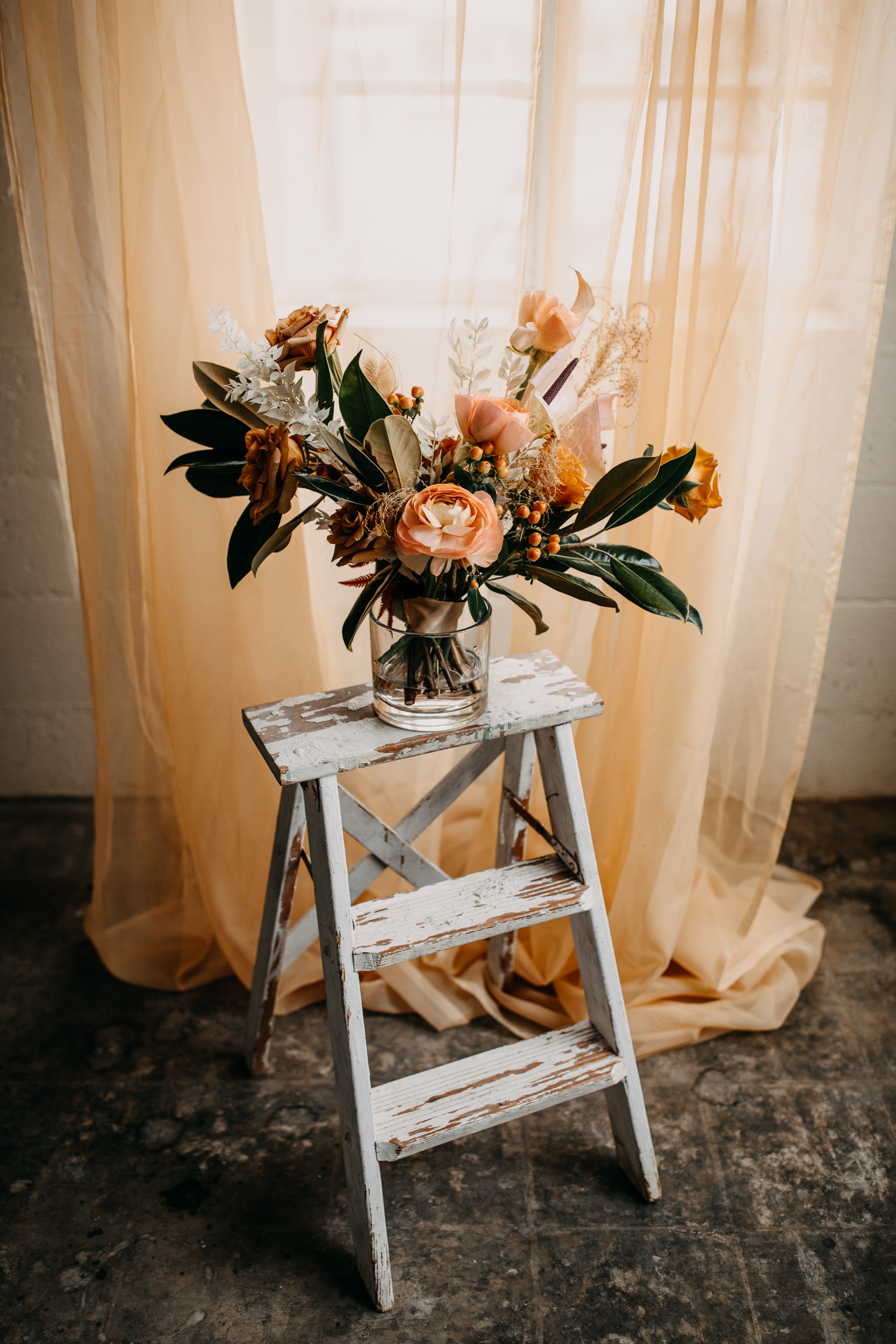 vintage wedding decor. distressed ladder. wedding with ladder. reception with ladder. vintage rentals. vintage wedding rentals. queen city blooms. beautiful blooms. ladders with bouquets. spring wedding. summer wedding. fall wedding. winter wedding. vintage wedding. natural wedding decor.